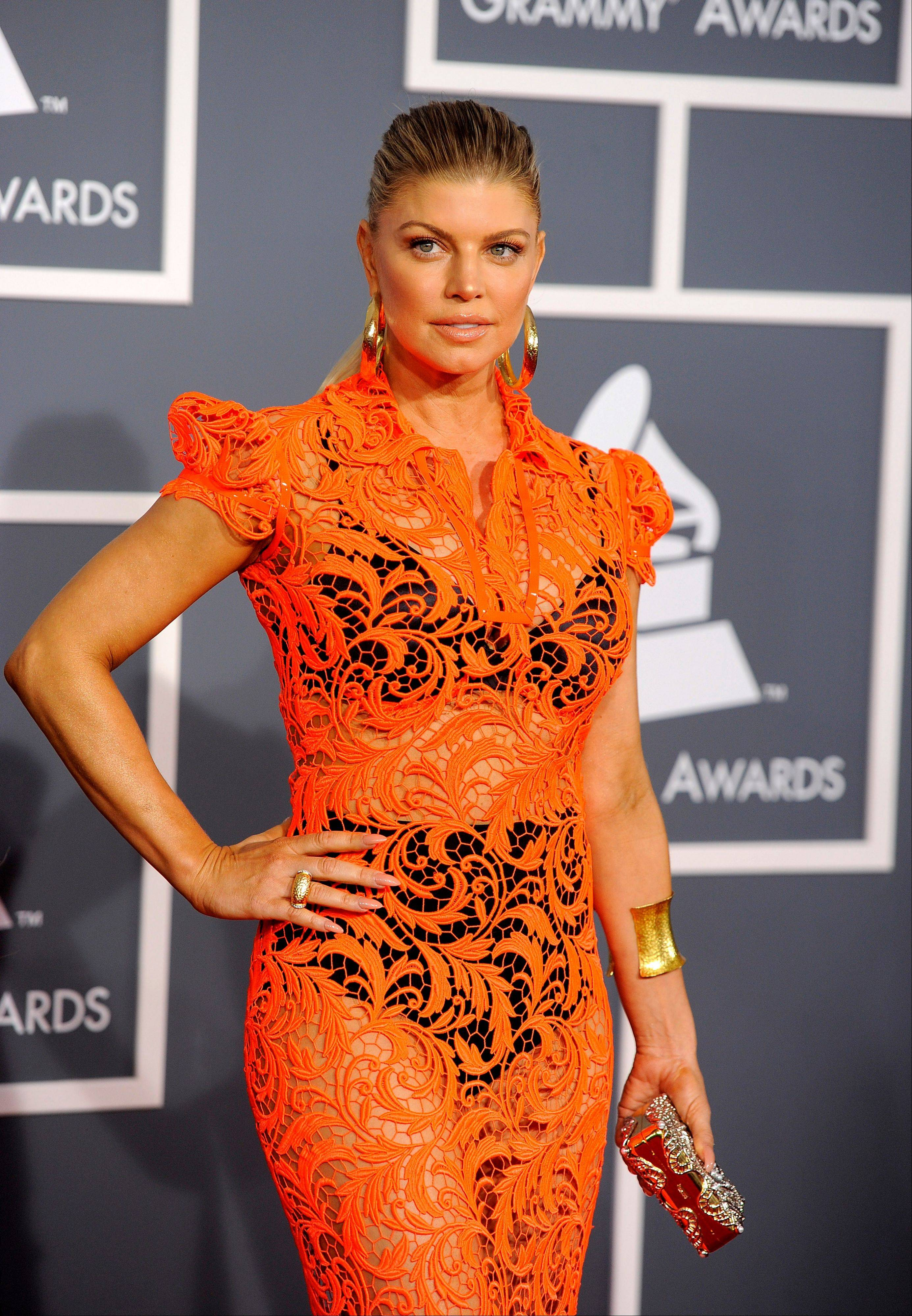 Fergie arrives Sunday at the 54th annual Grammy Awards in Los Angeles.