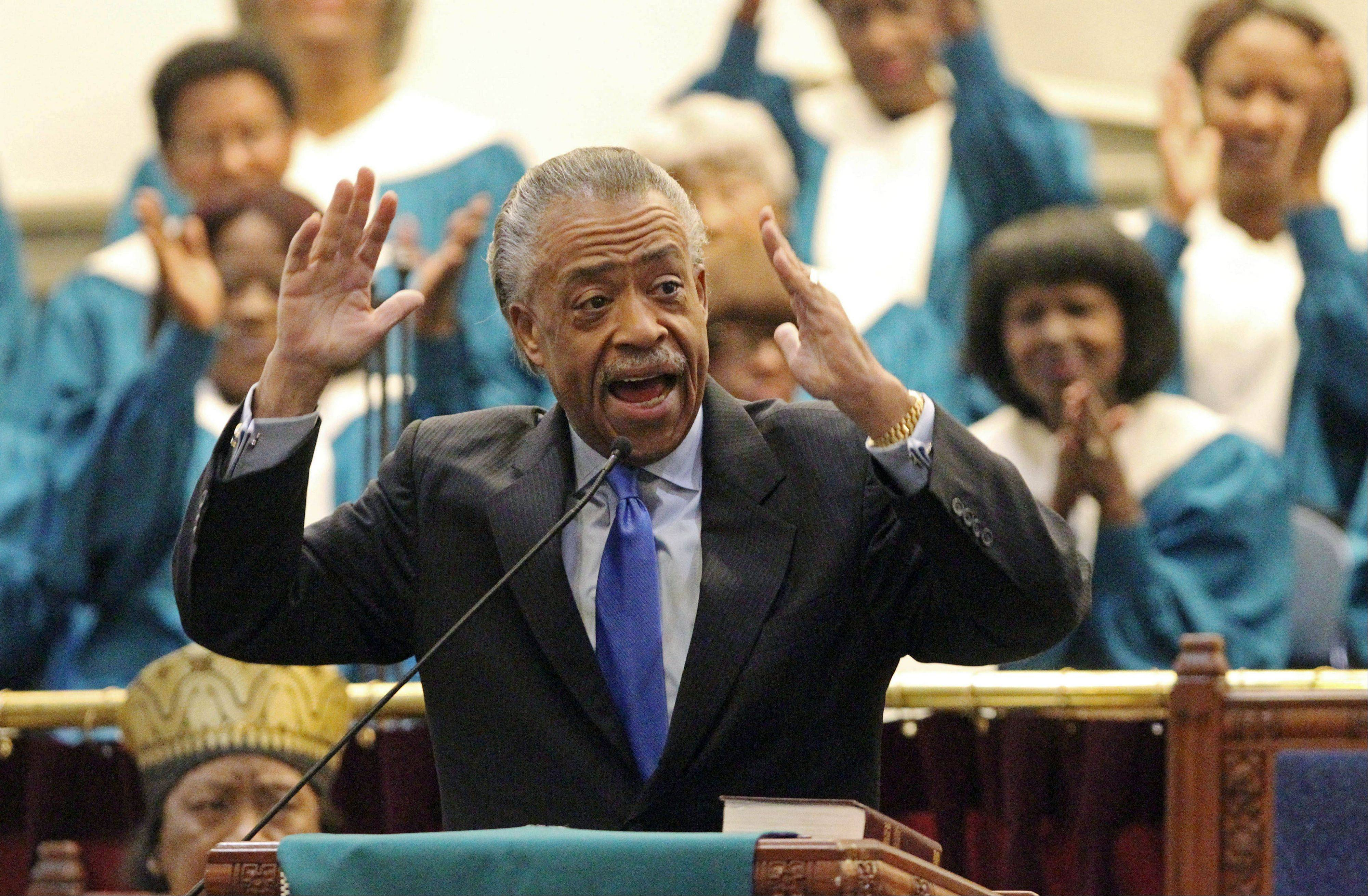 As members of the choir applaud, the Rev. Al Sharpton asks for a national day of prayer for Whitney Houston during regular Sunday services at Second Baptist Church in Los Angeles.