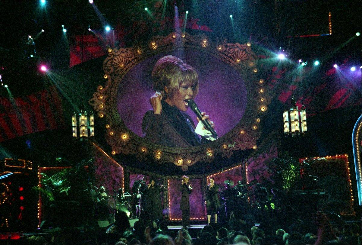 Whitney Houston performs during the Billboard Awards at the MGM Grand in Las Vegas on Dec. 7, 1998. Often referred to as the Queen of Pop music at her best, Houston died Saturday at the age of 48.