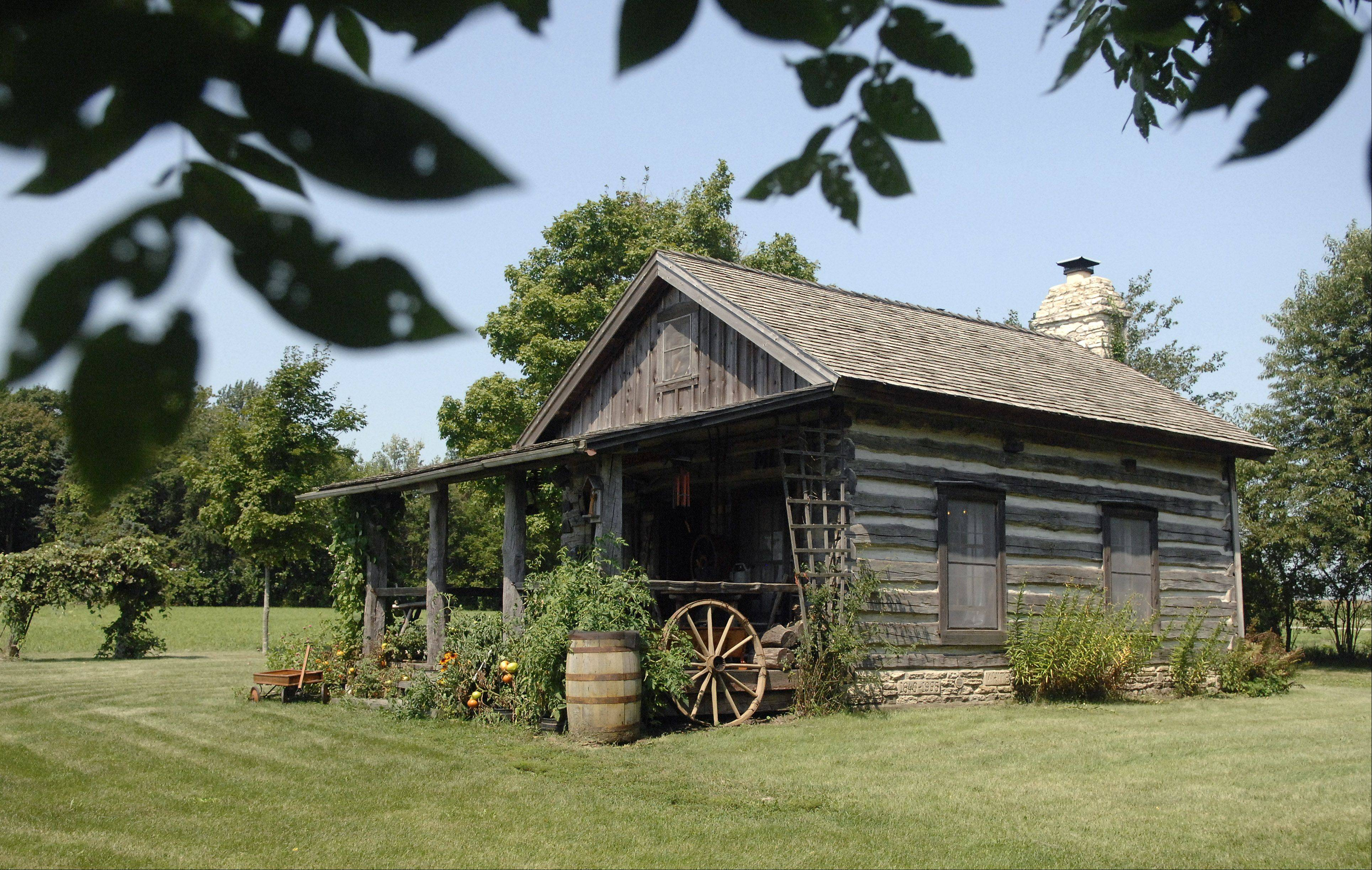 An old log house that John White moved to his farm near Batavia reminds us how pioneers lived.