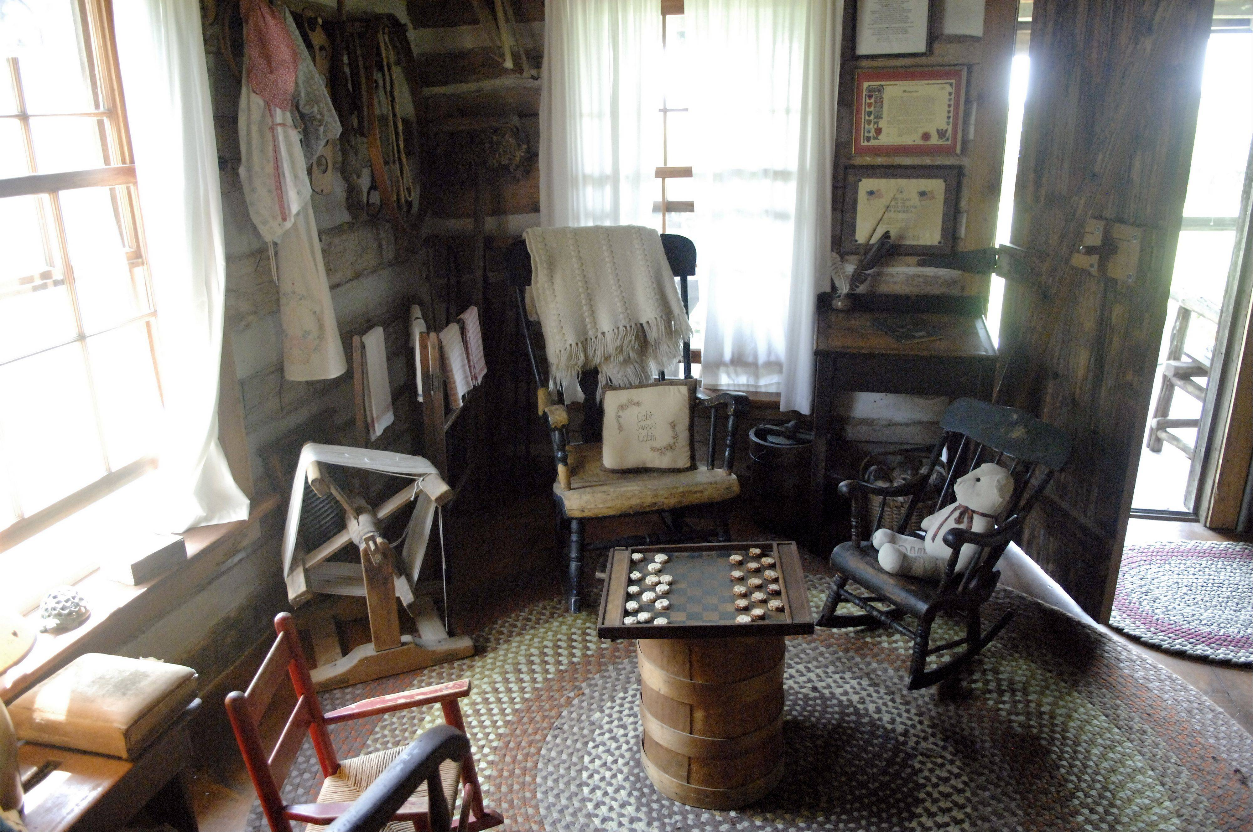 Rockers, a game of checkers and a yarn winder are just the beginning of artifacts in the Whites' log house near Batavia.