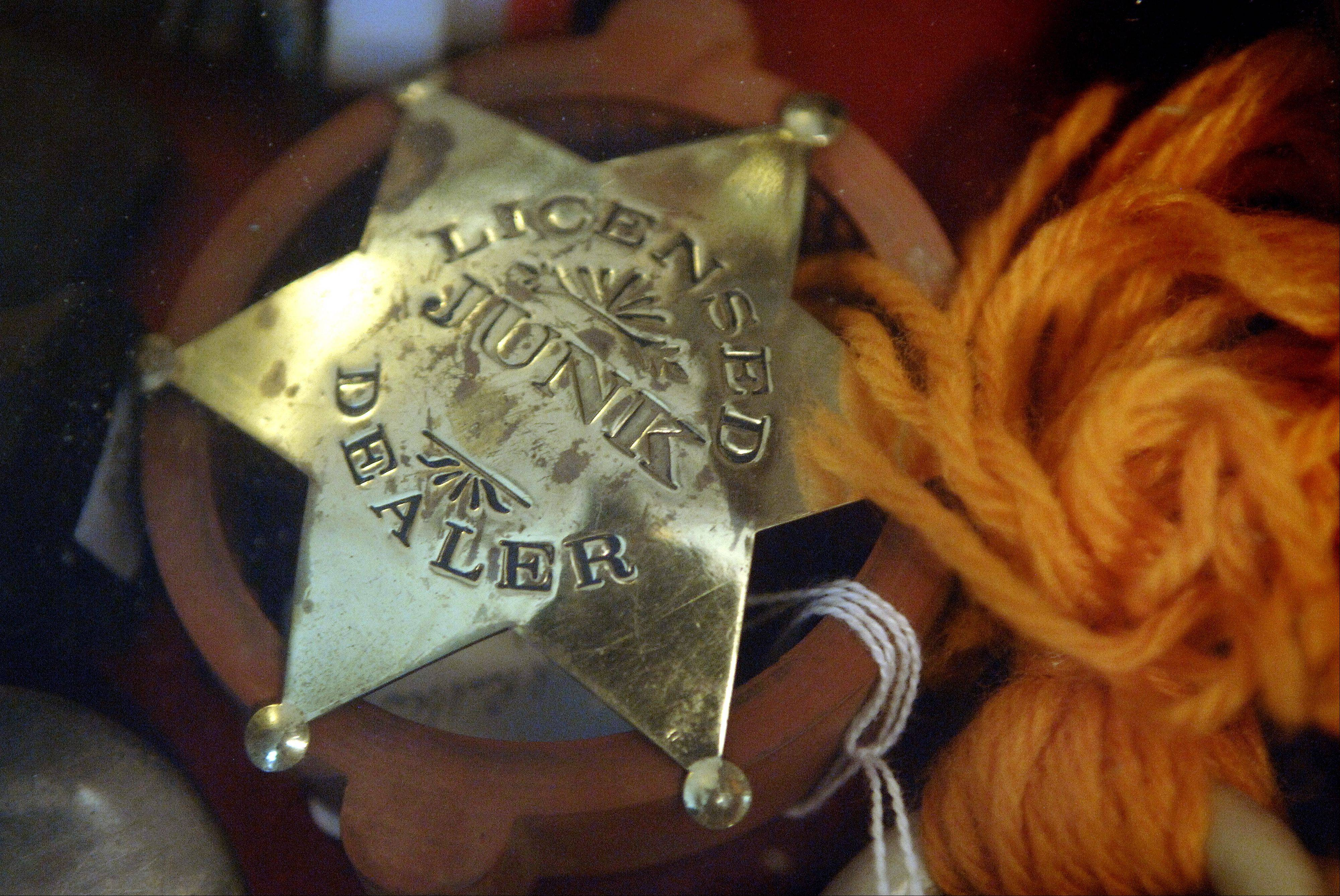 A badge sits inside a display cabinet at Milkhouse Antiques near Batavia.