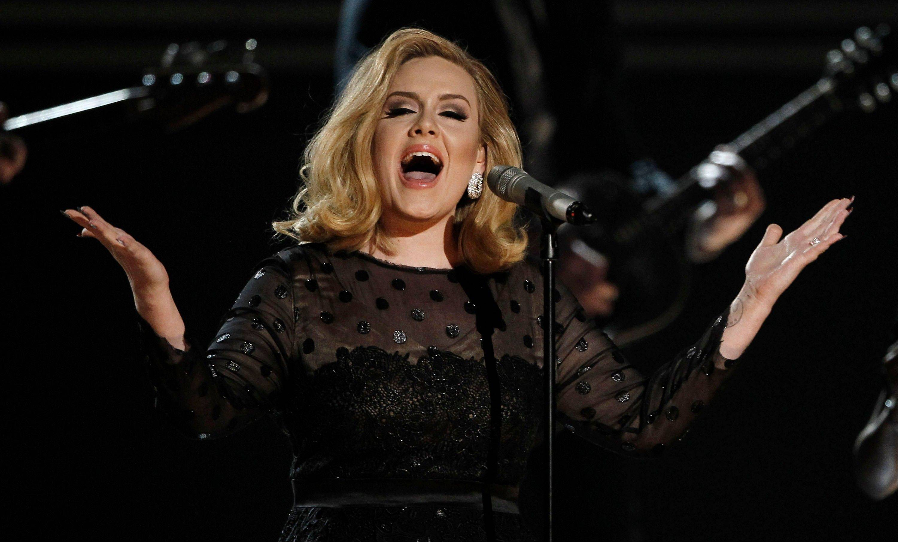 Adele performs during the 54th annual Grammy Awards Sunday in Los Angeles.