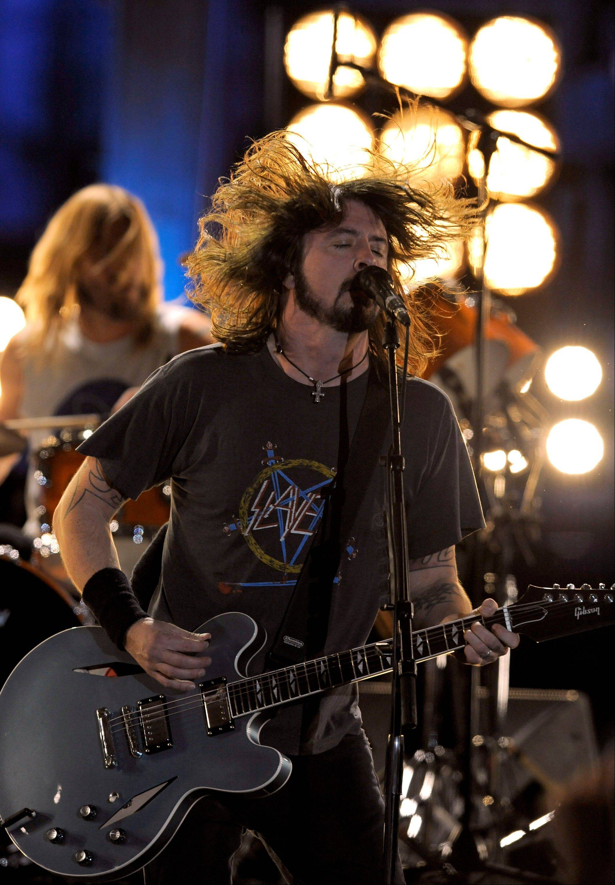 Dave Grohl and the Foo Fighters perform Sunday during the 54th annual Grammy Awards in Los Angeles.
