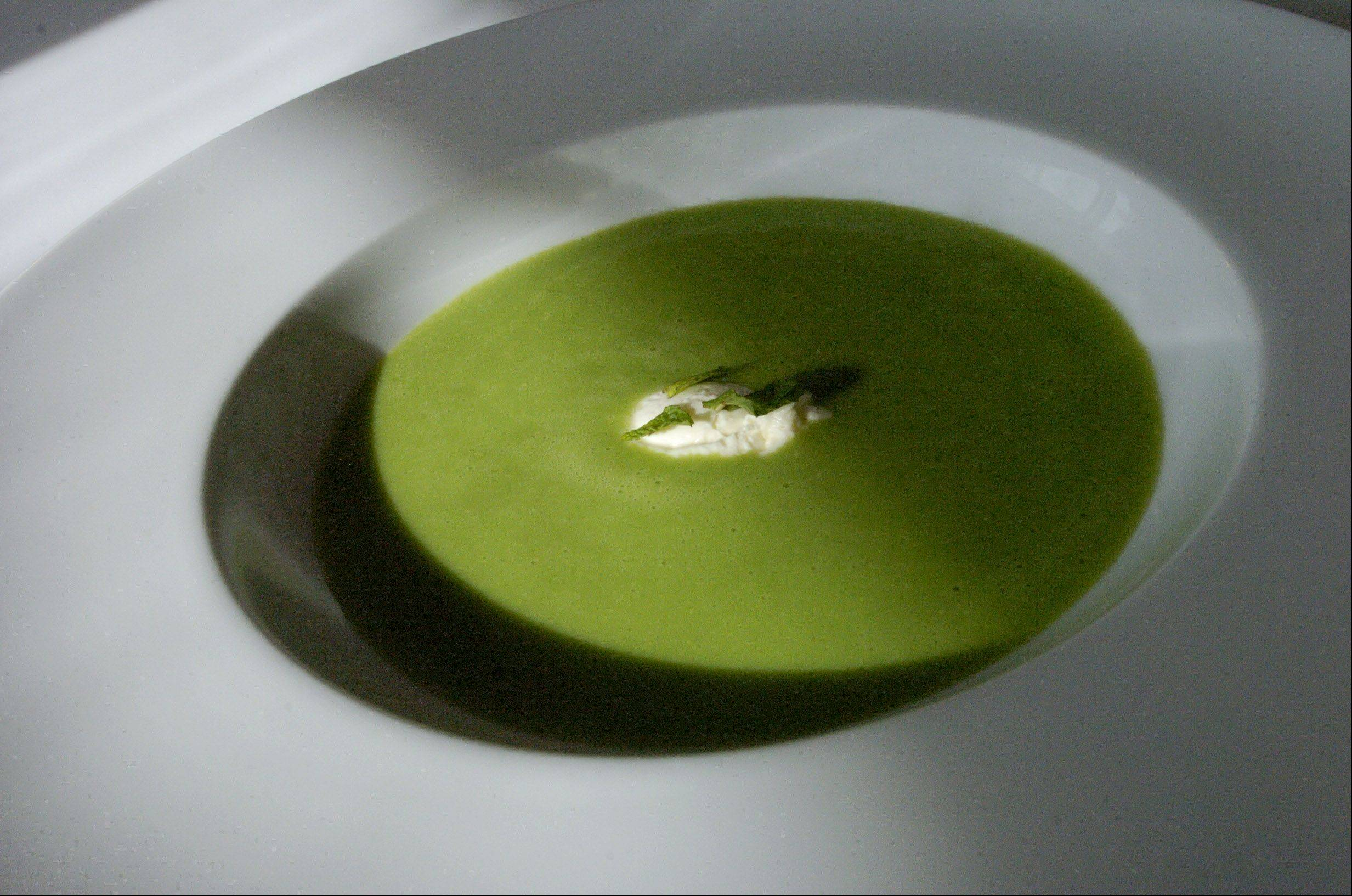 Chef Justin Perdue cools the cooked pea soup to maintain it's vibrant color. He reheats it before serving.