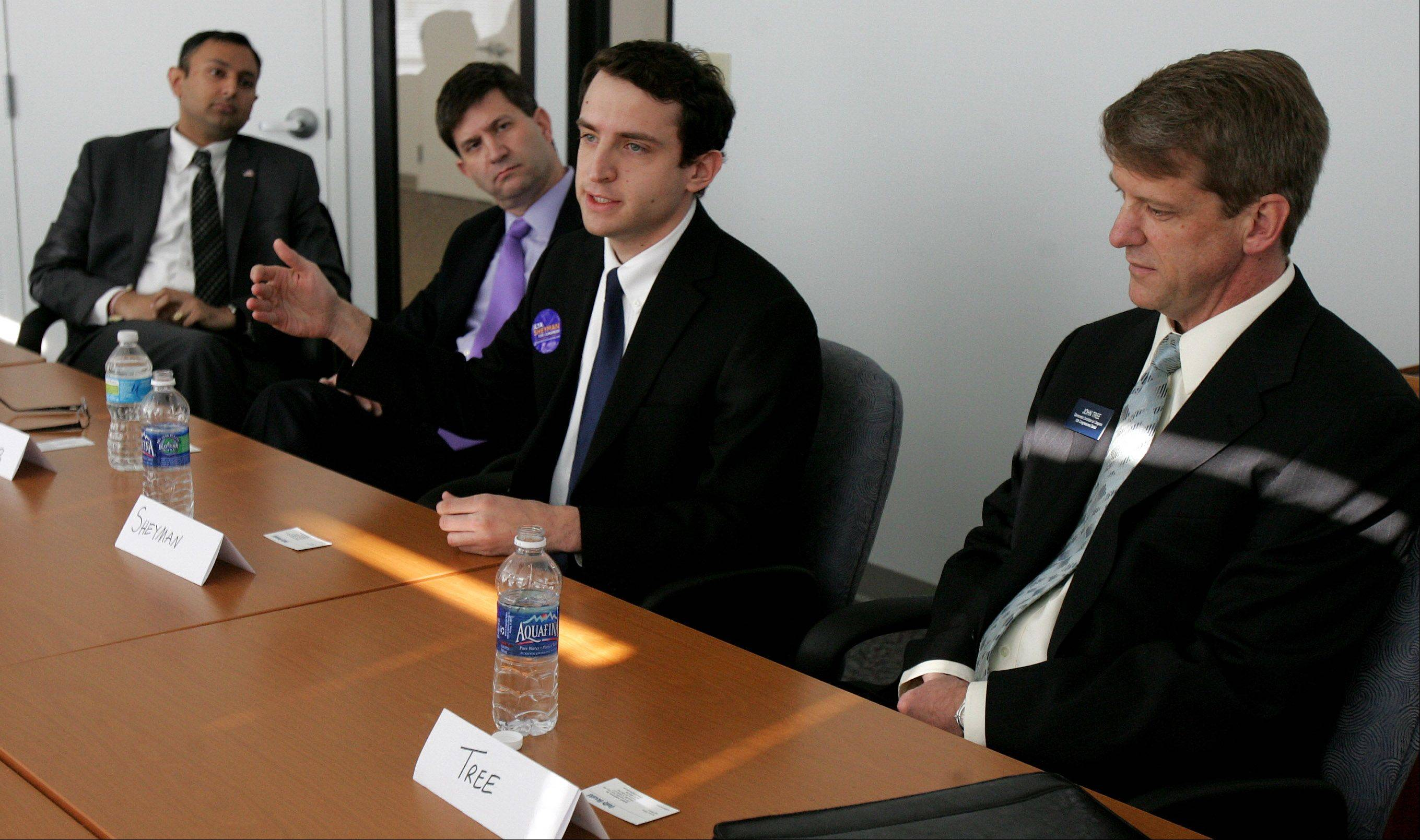 Democratic candidates Vivek Bavda, from left, Brad Schneider, Ilya Sheyman, and John Tree recently met with the Daily Herald at its office in Libertyville.