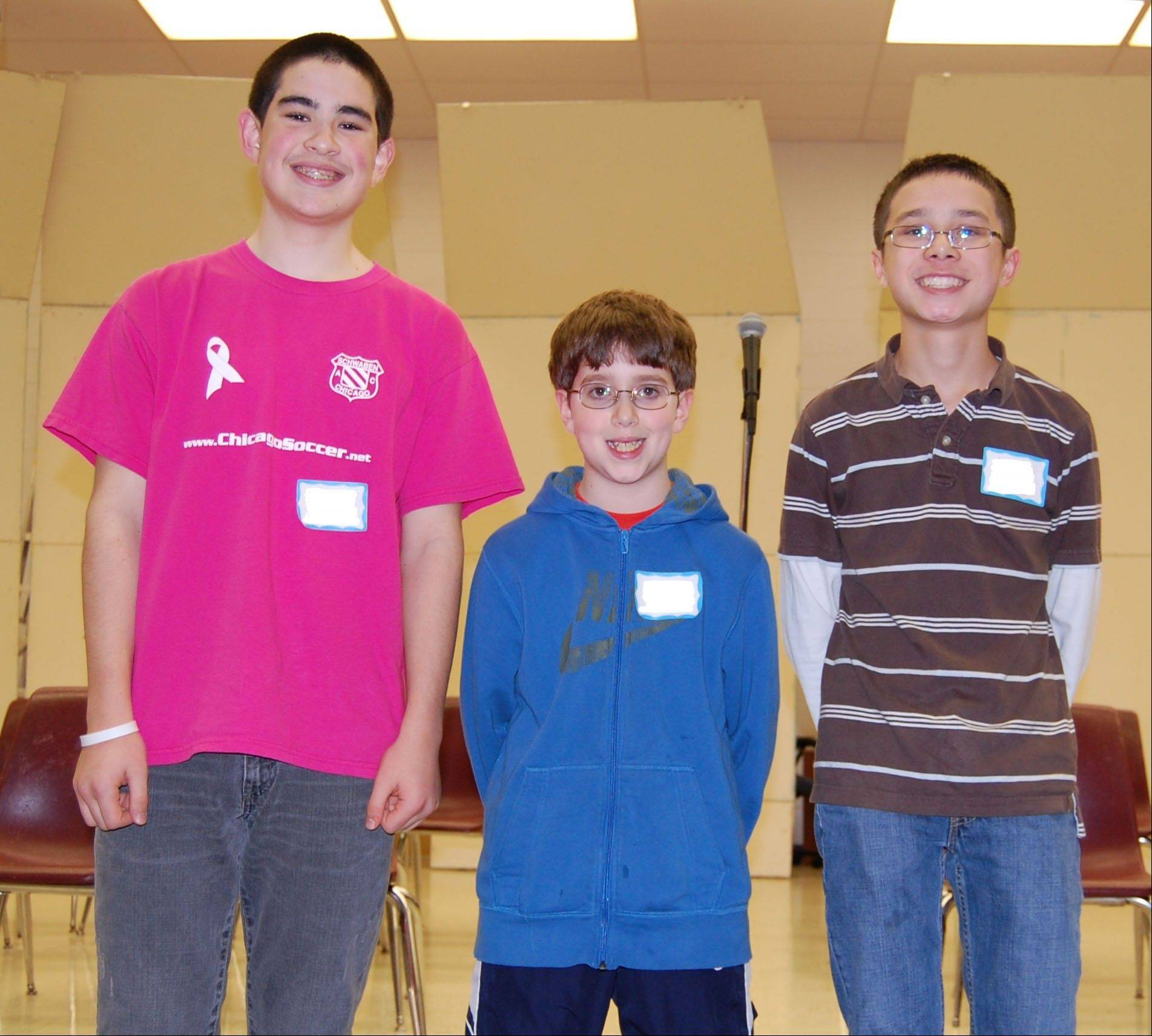 District 103 spelling bee winners, from left, first-place winner eighth-grader Kazemi Adachi, second-place winner sixth-grader Tyler Gordon and third-place winner eighth-grader Alec Smith.