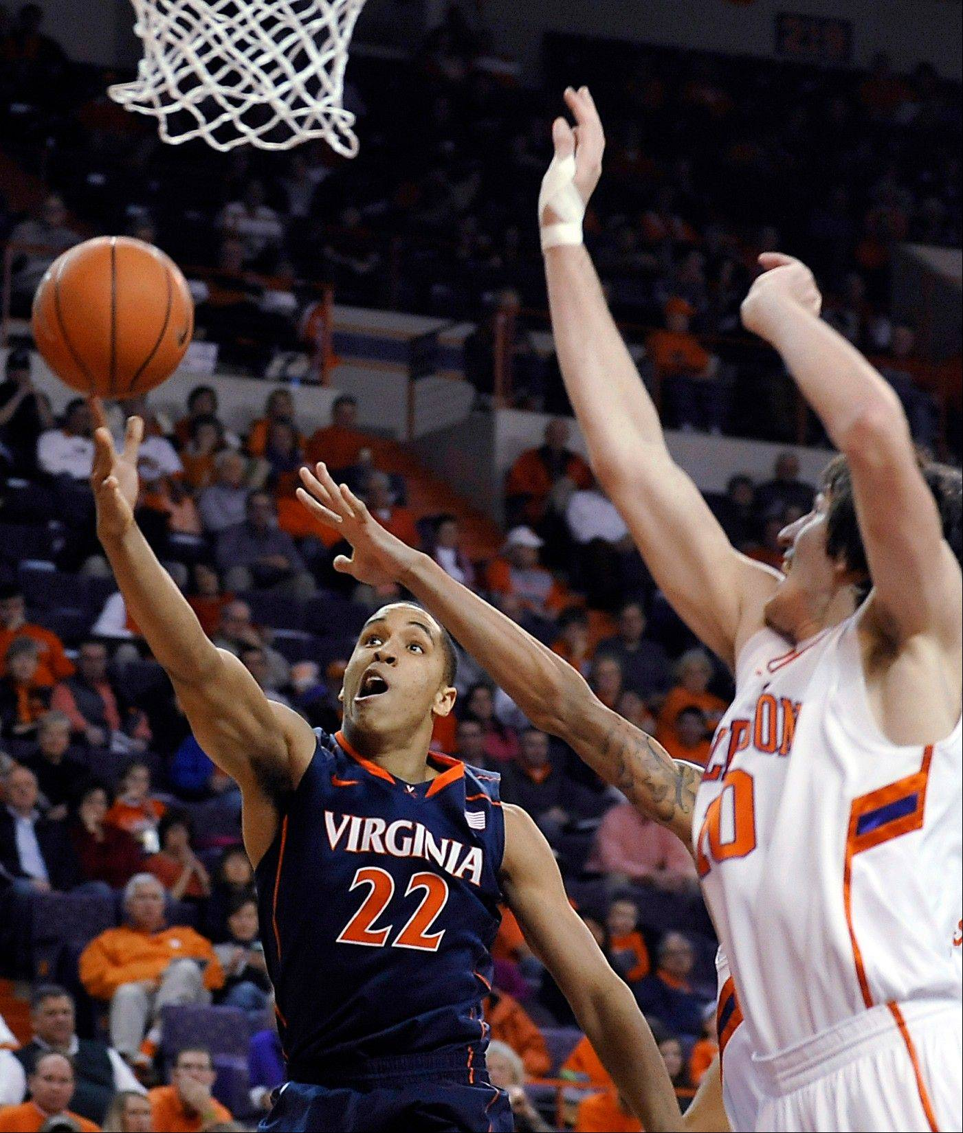 Clemson runs past No. 22 Virginia 60-48