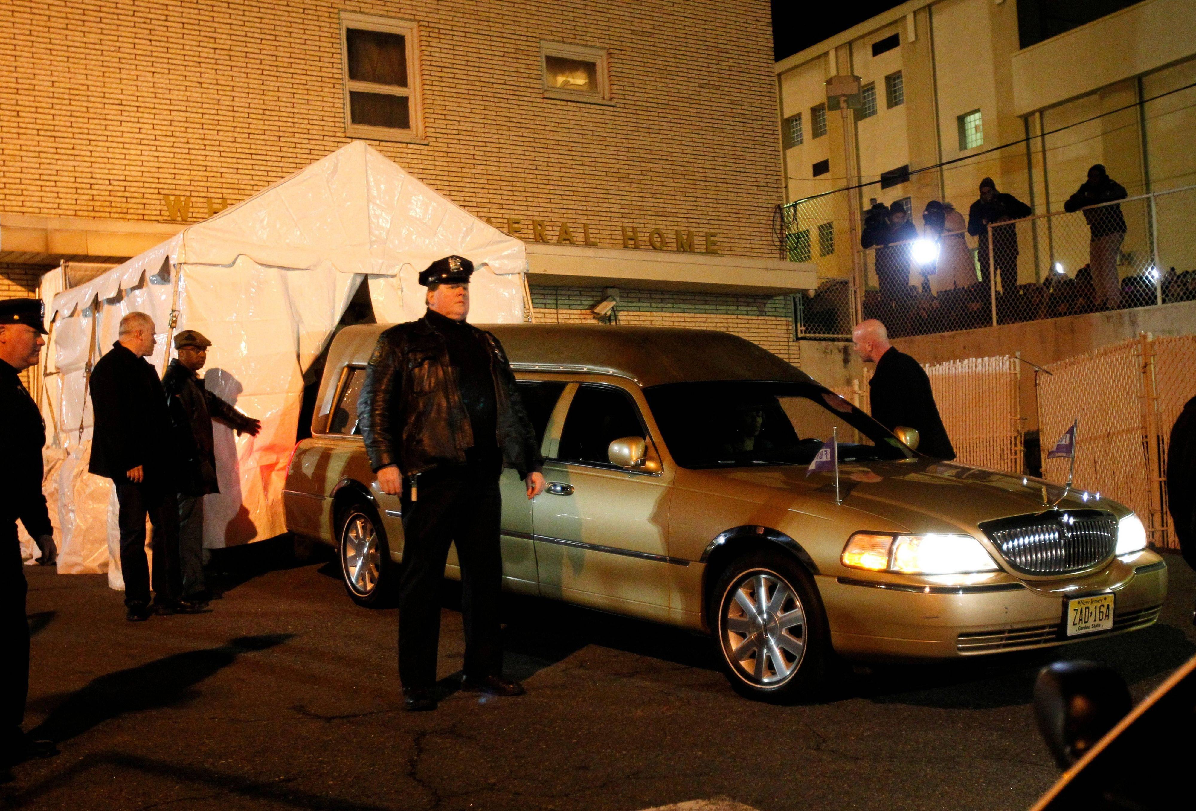 The body of Whitney Houston arrives at Whigham Funeral Home, in Newark, N.J., Monday, Feb. 13, 2012. The 48-year-old pop star was found dead in the bathtub in her hotel room at the Beverly Hilton Hotel on Saturday, hours before she was supposed to appear at a pre-Grammy gala.