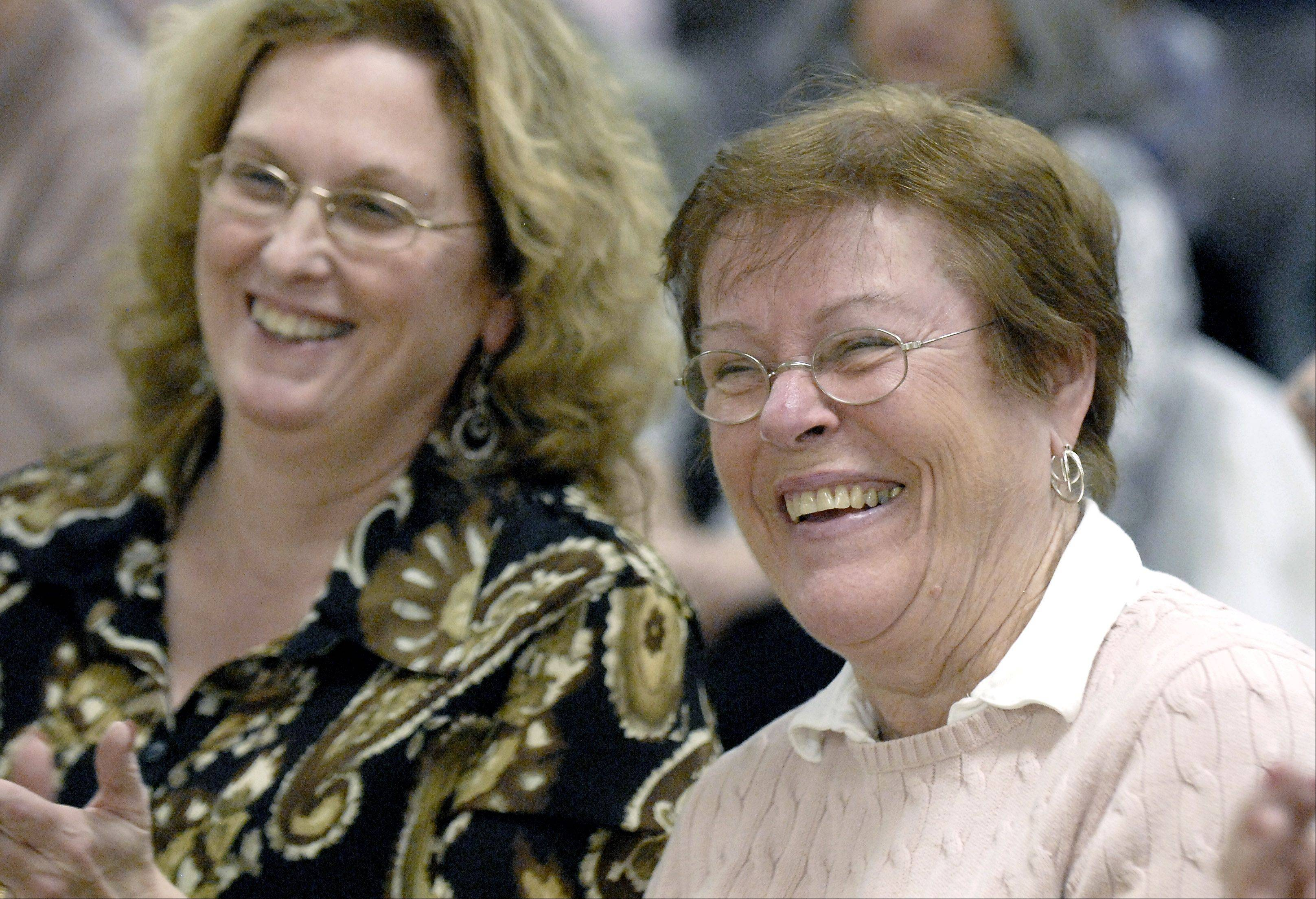 Phyllis Kmetz of Downers Grove, right, smiles as she finds out she won a cookbook by chef Jen Bucko Lamplough of Batavia during a cooking demonstration by Lamplough at the Northern Illinois Food Bank. Kmetz is a volunteer at the food bank.