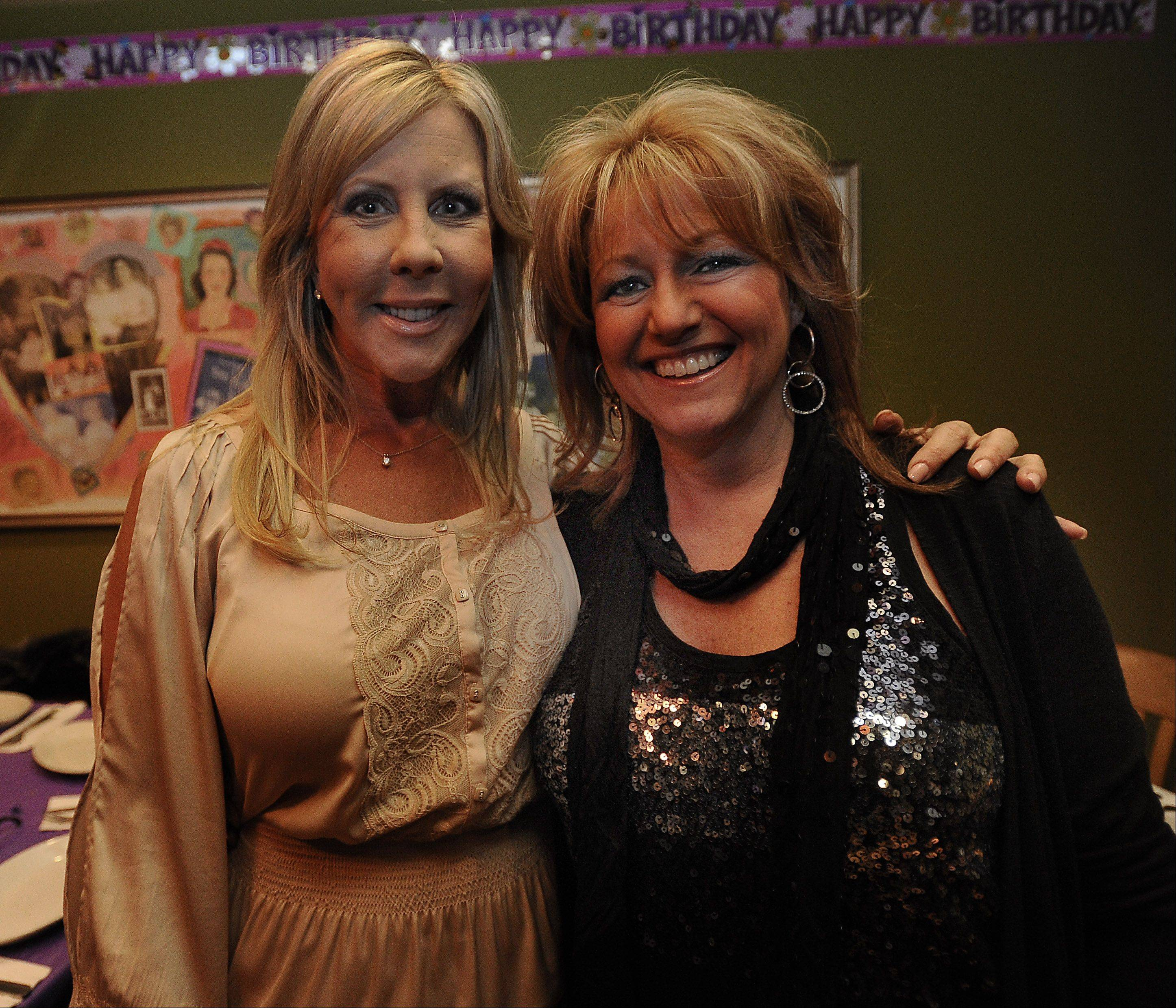 Vicki Gunvalson, left, comes home to the Northwest suburbs to celebrate the 50th birthday of her old friend and Fremd High School classmate, Jeannie Jaeger, of Barrington.