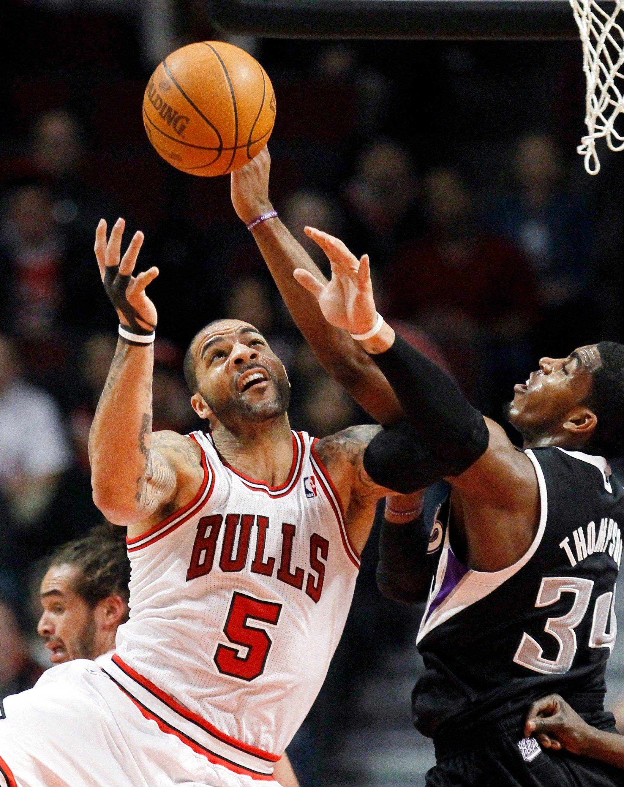 Bulls power forward Carlos Boozer battles Sacramento Kings center Jason Thompson for a rebound Tuesday during the first half.