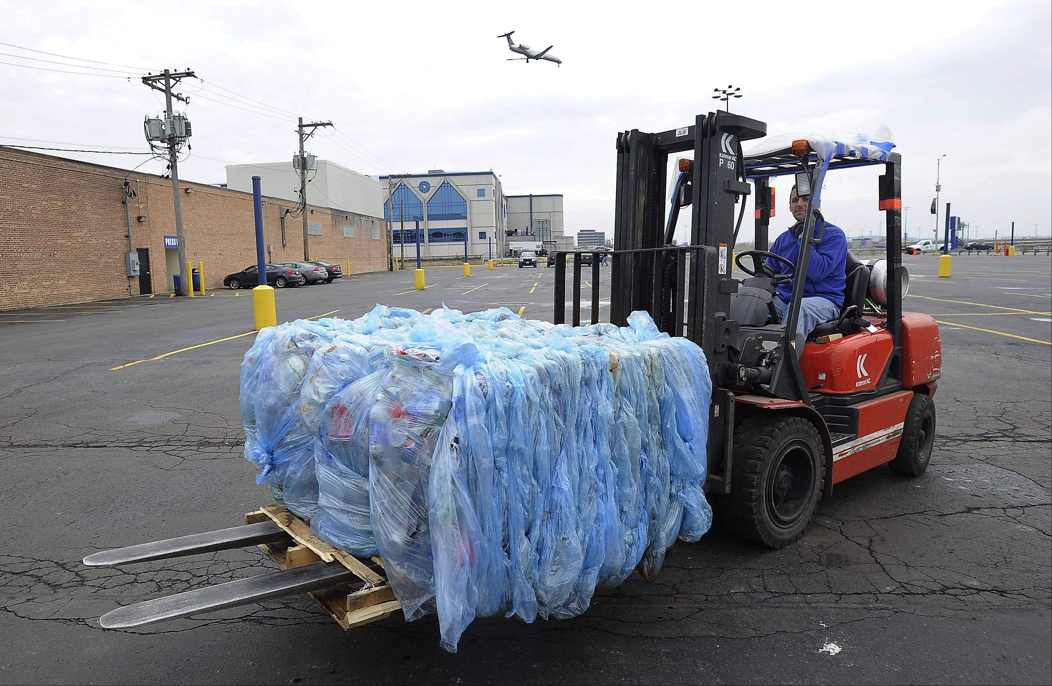 Jim Napoli of Rosemont, a carpenter at the Allstate Arena, hauls waste away from the arena.