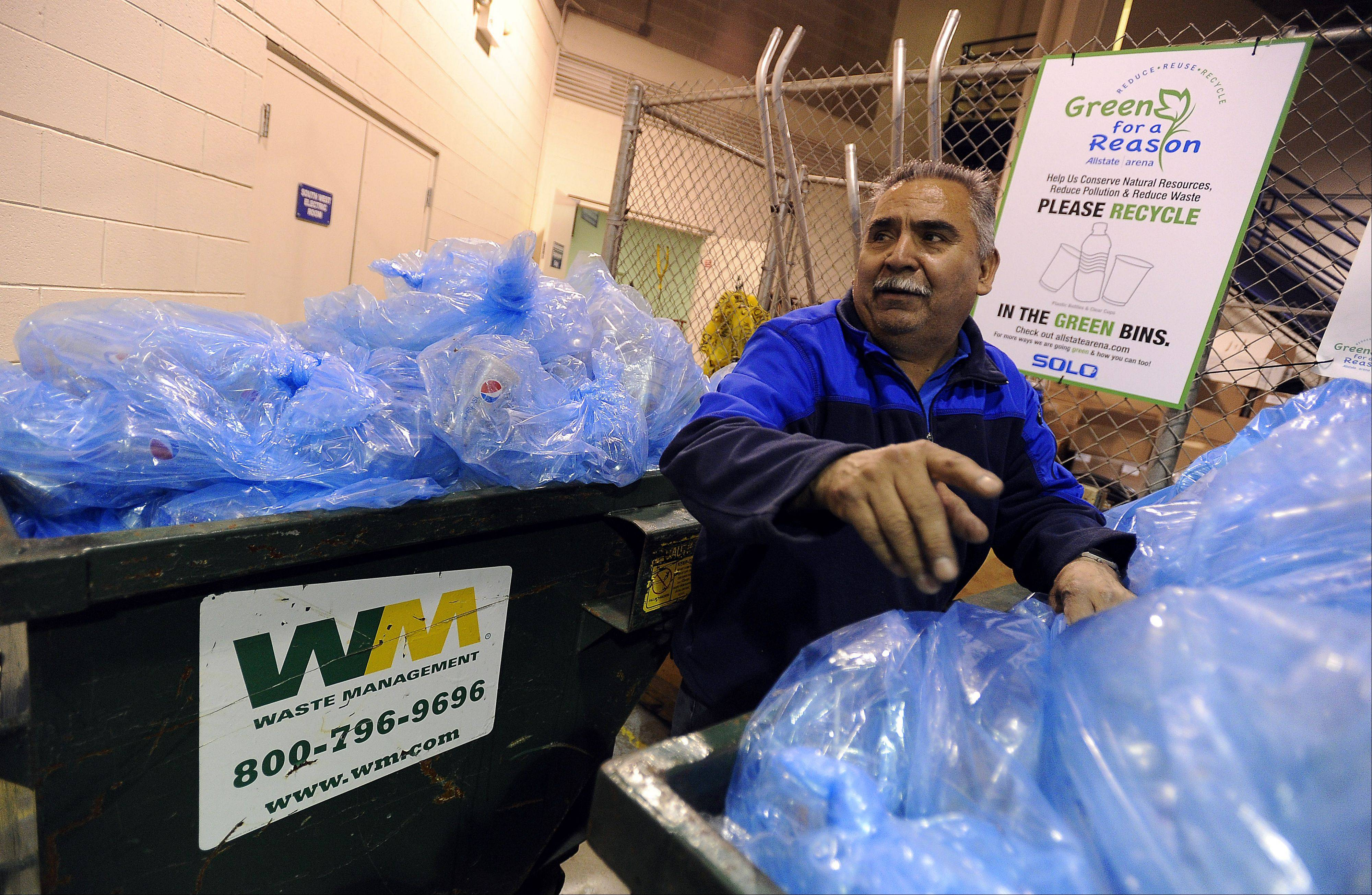 Ramon Hernandez hauls Allstate Arena waste away.