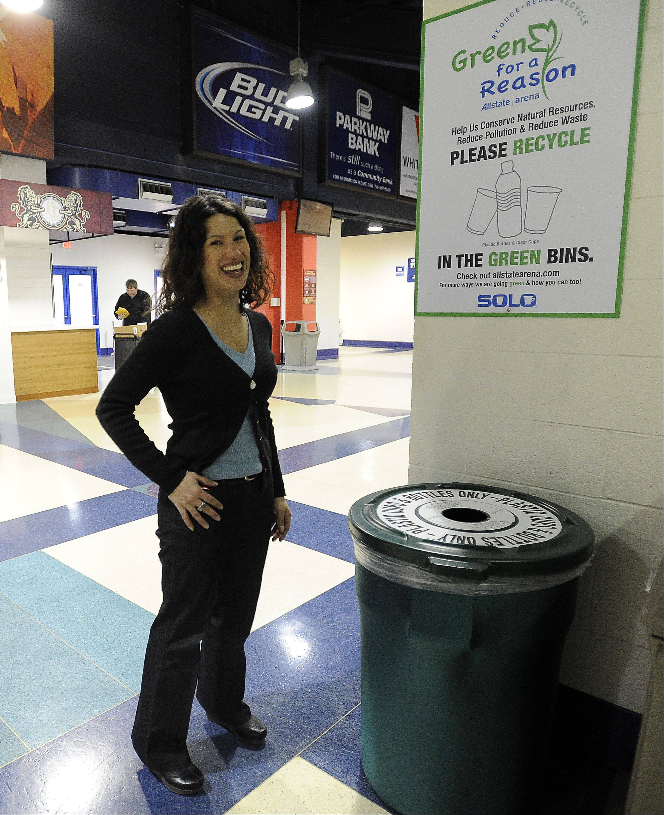 Stephanie Katsaros, sustainability manager at the Allstate Arena, shows off one of the many waste bins.