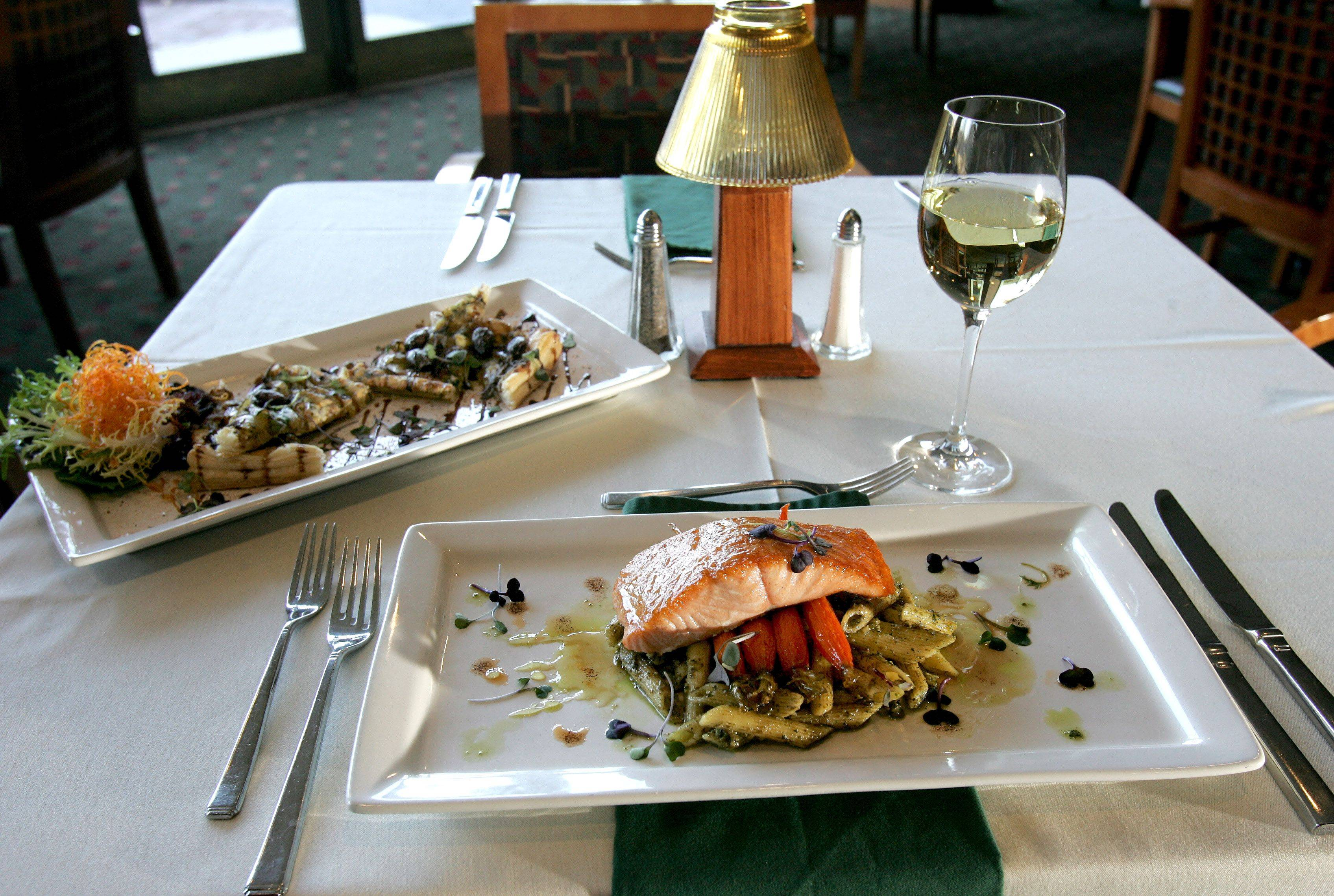 Confit of onion and fennel, left, and seared Pacific salmon with lavender-limoncello syrup will be offered at Prairie River at Eaglewood Resort and Spa in Itasca during Restaurant Week.