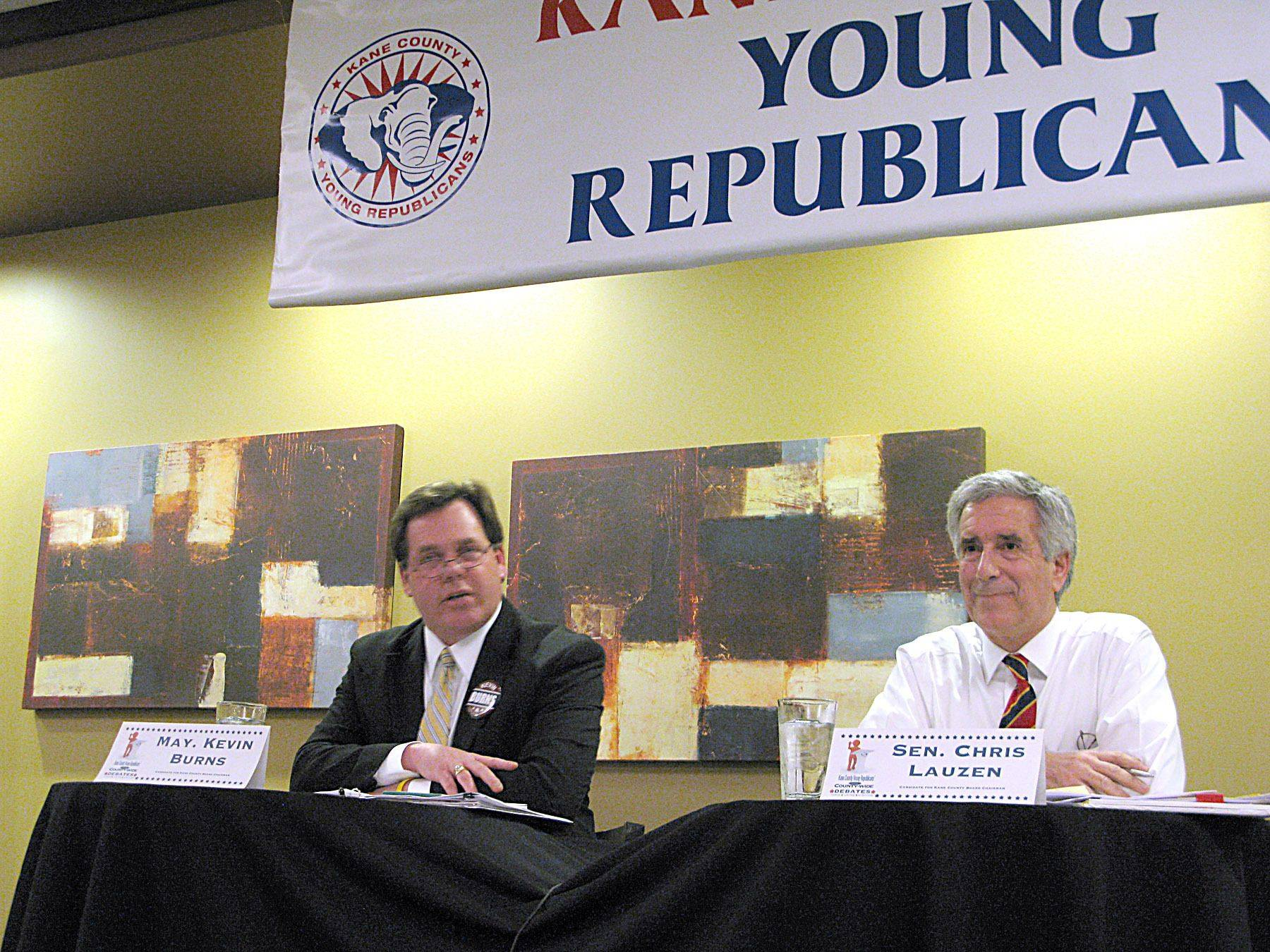 JIM FULLER/jfuller@dailyherald.com Geneva Mayor Kevin Burns, left, and state Sen. Chris Lauzen drew a hard line on what type of Republican each of them is Wednesday night in a debate at the Urban Grille in Geneva.