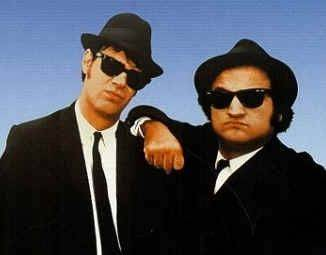 "Dan Aykroyd, John Belushi, in the 1980 movies ""The Blues Brothers""."