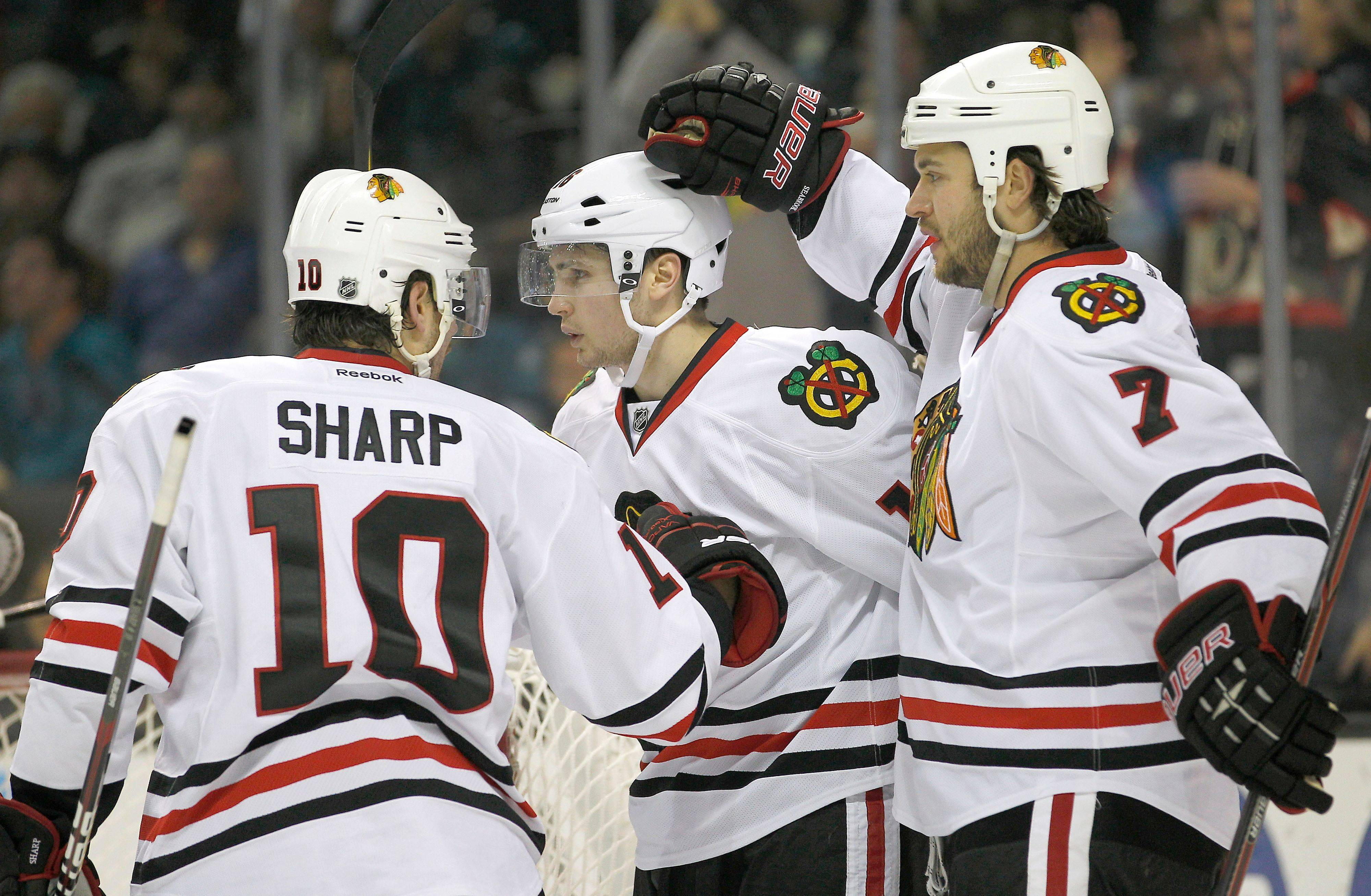 Patrick Sharp and Brent Seabrook (7) are two of the three Blackhawks who were with the team back when times were really bleak and the Hawks had trouble winning.