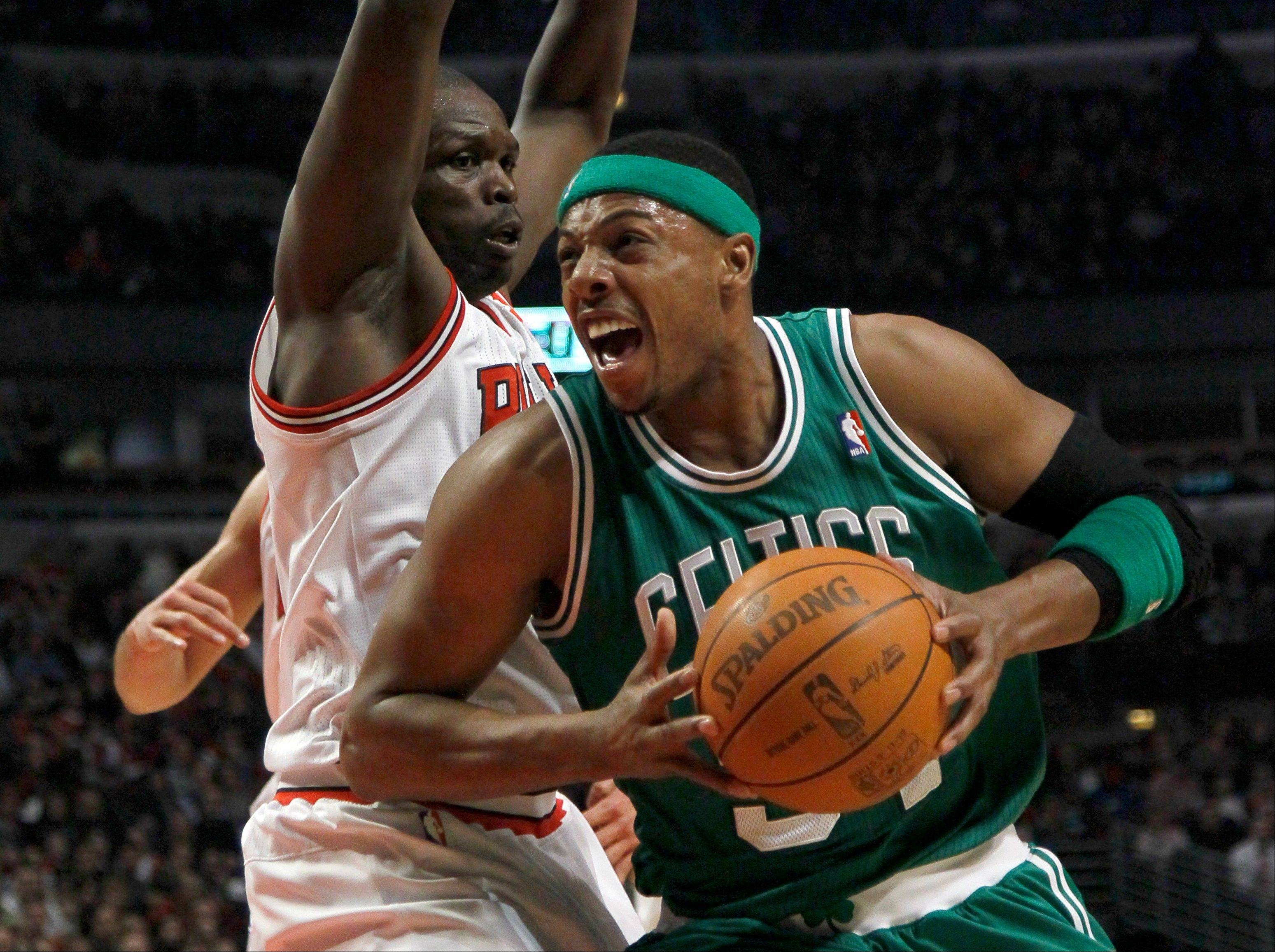 Boston Celtics small forward Paul Pierce tries to drive past Bulls small forward Luol Deng during the first half Thursday night at the United Center.
