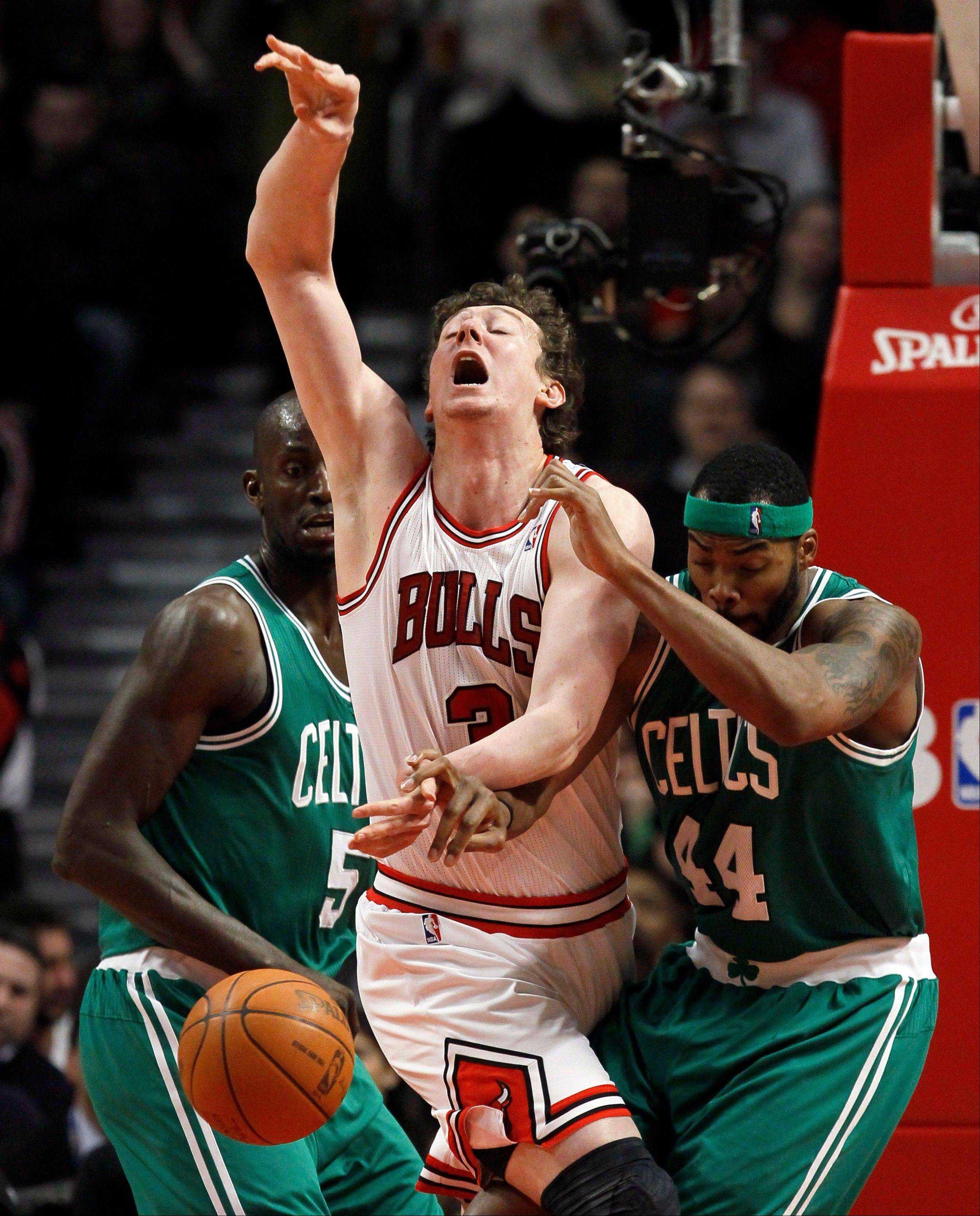 Bulls center Omer Asik reacts after Boston Celtics power forward Chris Wilcox knocked the ball from his hands Thursday as Celtics' Kevin Garnett (5) watches during the first half.