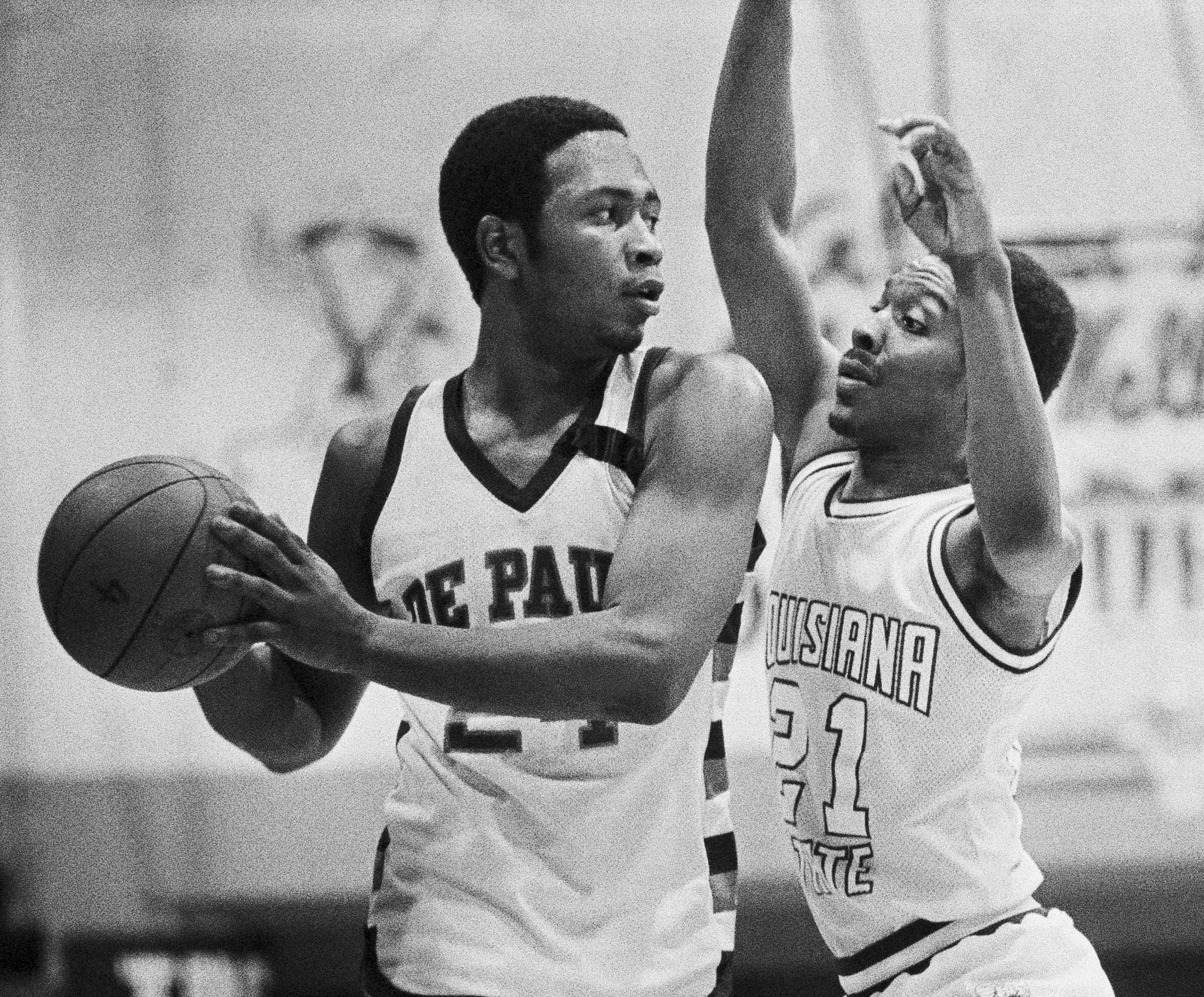 DePaul's Mark Aguirre, left, looks for an open man as he's pressured by LSU's Ethan Martin during a 1980 game.