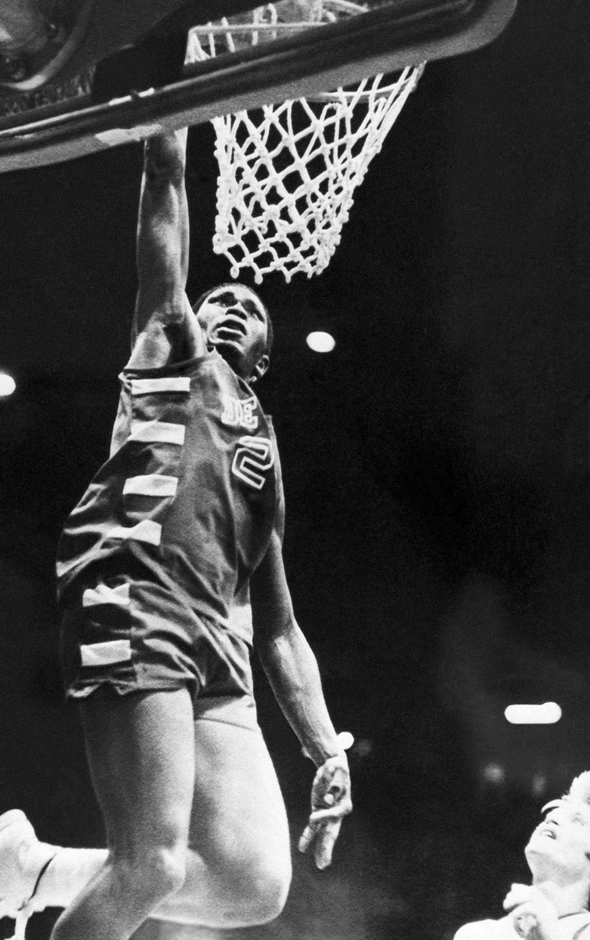 DePaul All-American Mark Aguirre floats up to score against Butlers Tim McRoberts durng a 1981