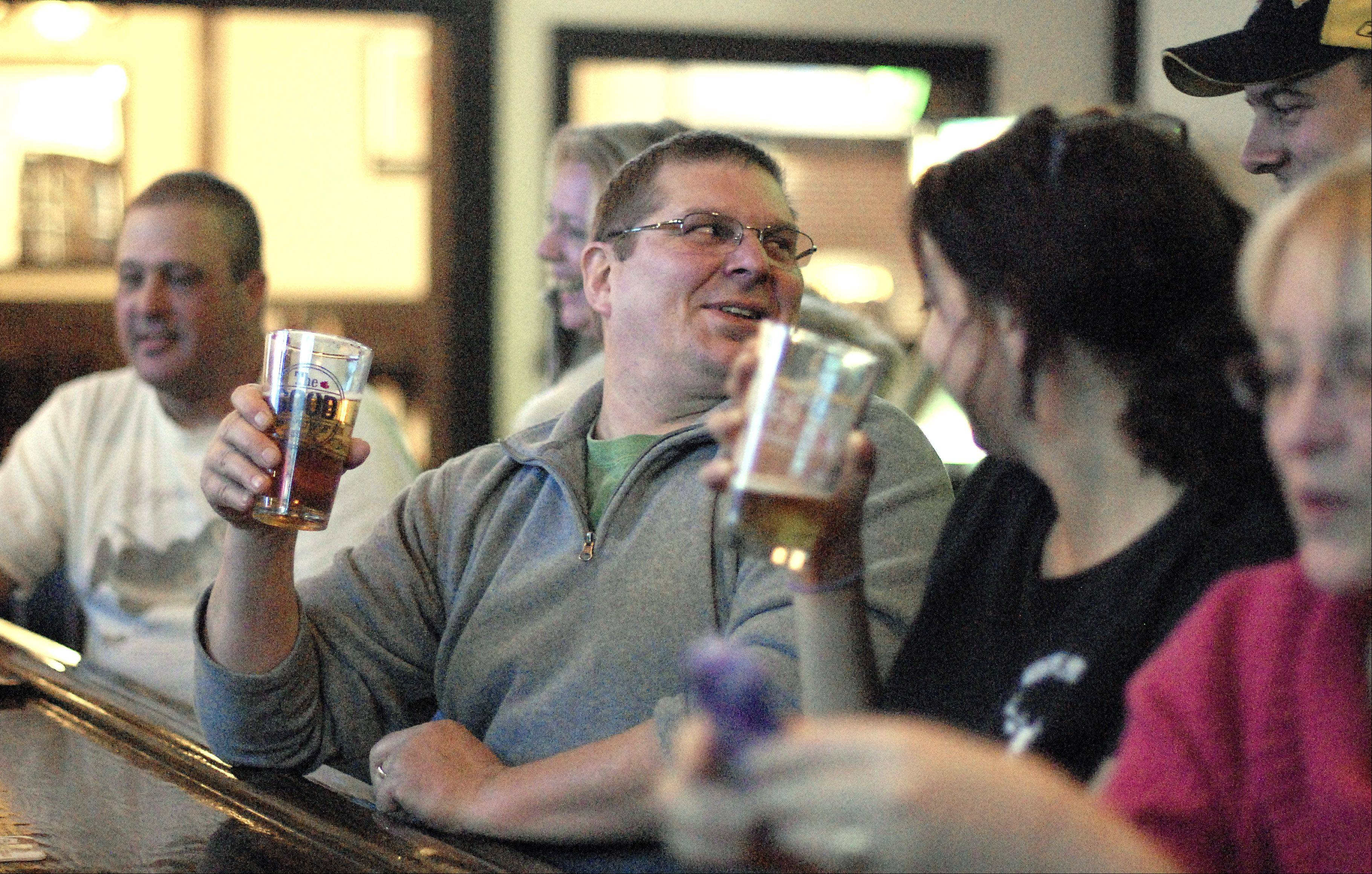Curtis Alf of St. Charles sits at the bar at White Stag Tavern, which draws a laid-back crowd.