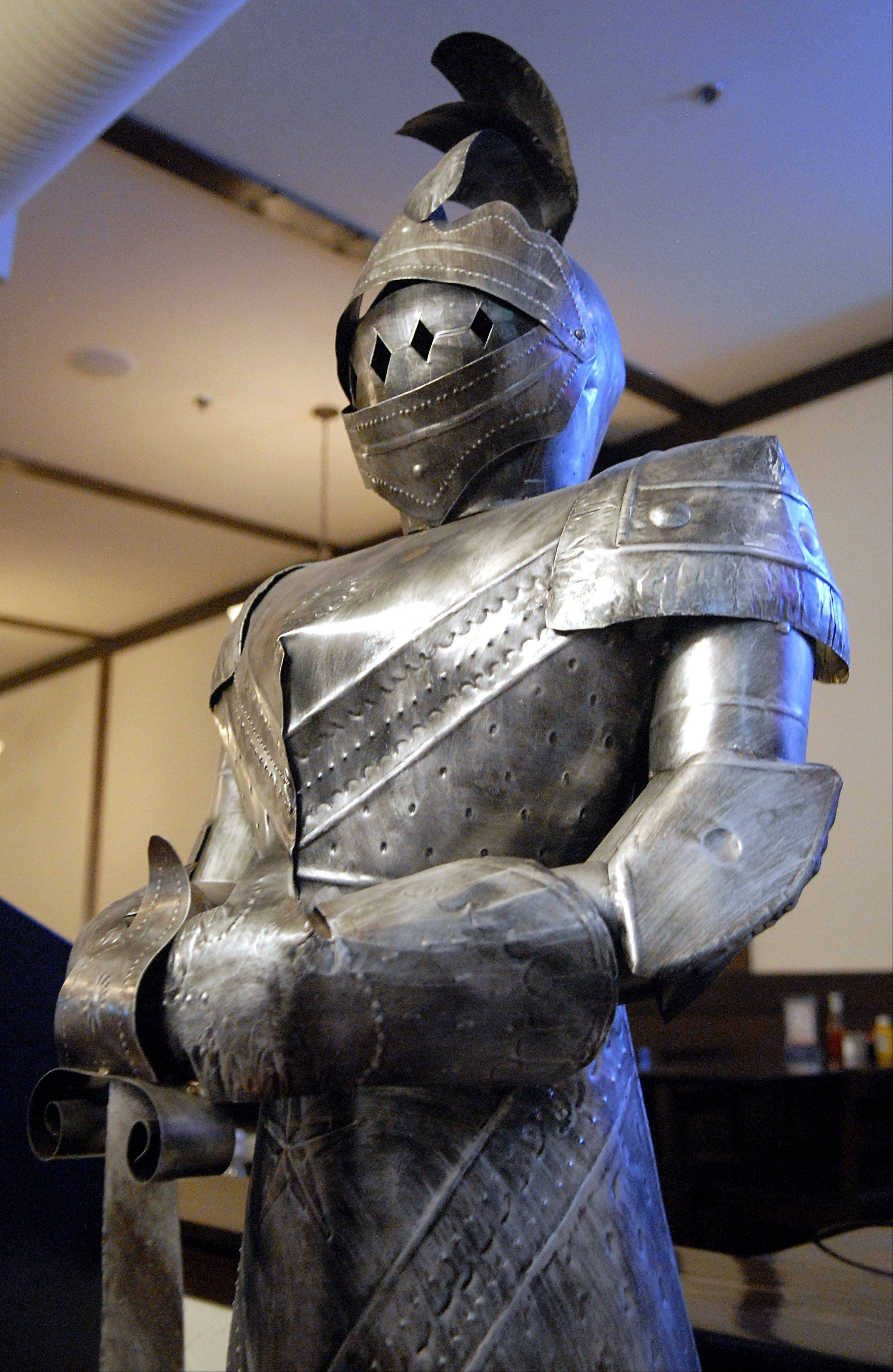 A suit of armor greets patrons as they enter the White Stag Tavern in St. Charles.