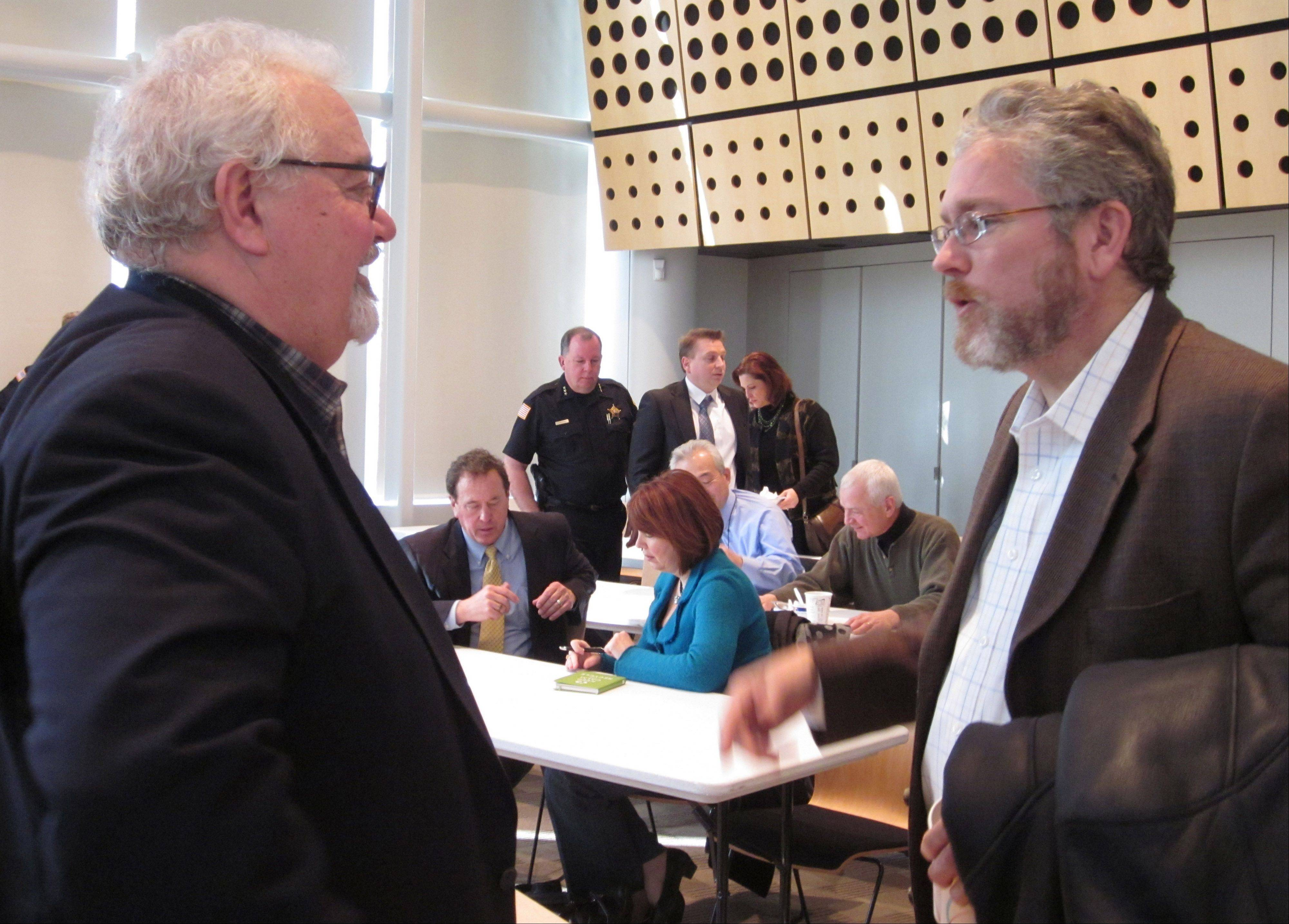 Vernon Hills Mayor Roger Byrne, left, talks Thursday with Stephen Park, senior vice president of the Alter Group and a Gurnee village trustee, after his state of the village presentation. Vernon Hills has seen an increase in sales tax and is on sound financial footing, Byrne said.