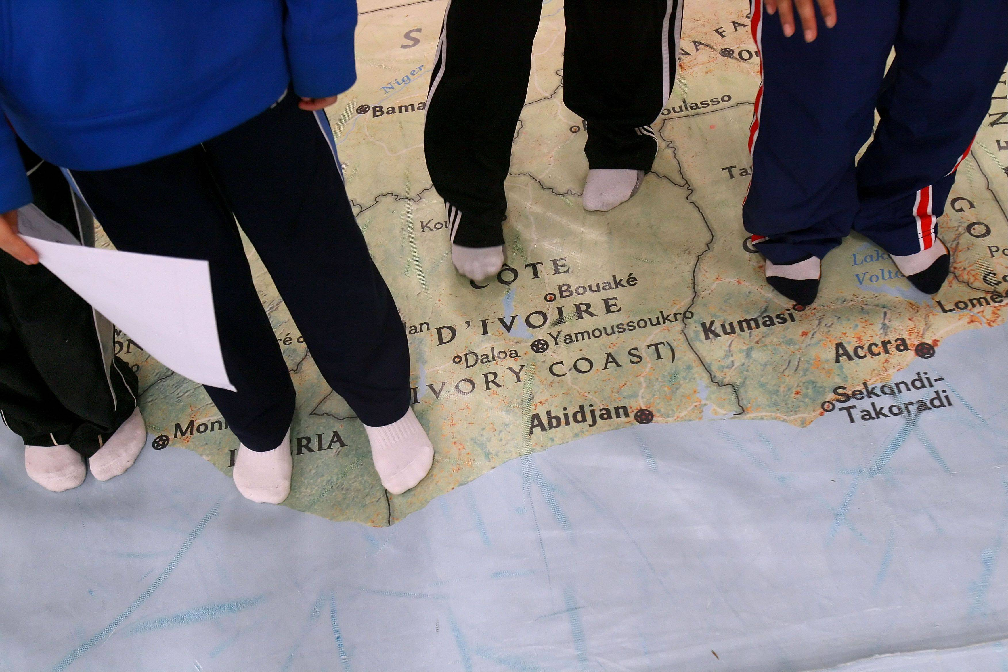 Kids locate African countries on a giant map of Africa at Half Day School in Lincolnshire. The map is part of National Geographic's Giant Traveling Maps program.