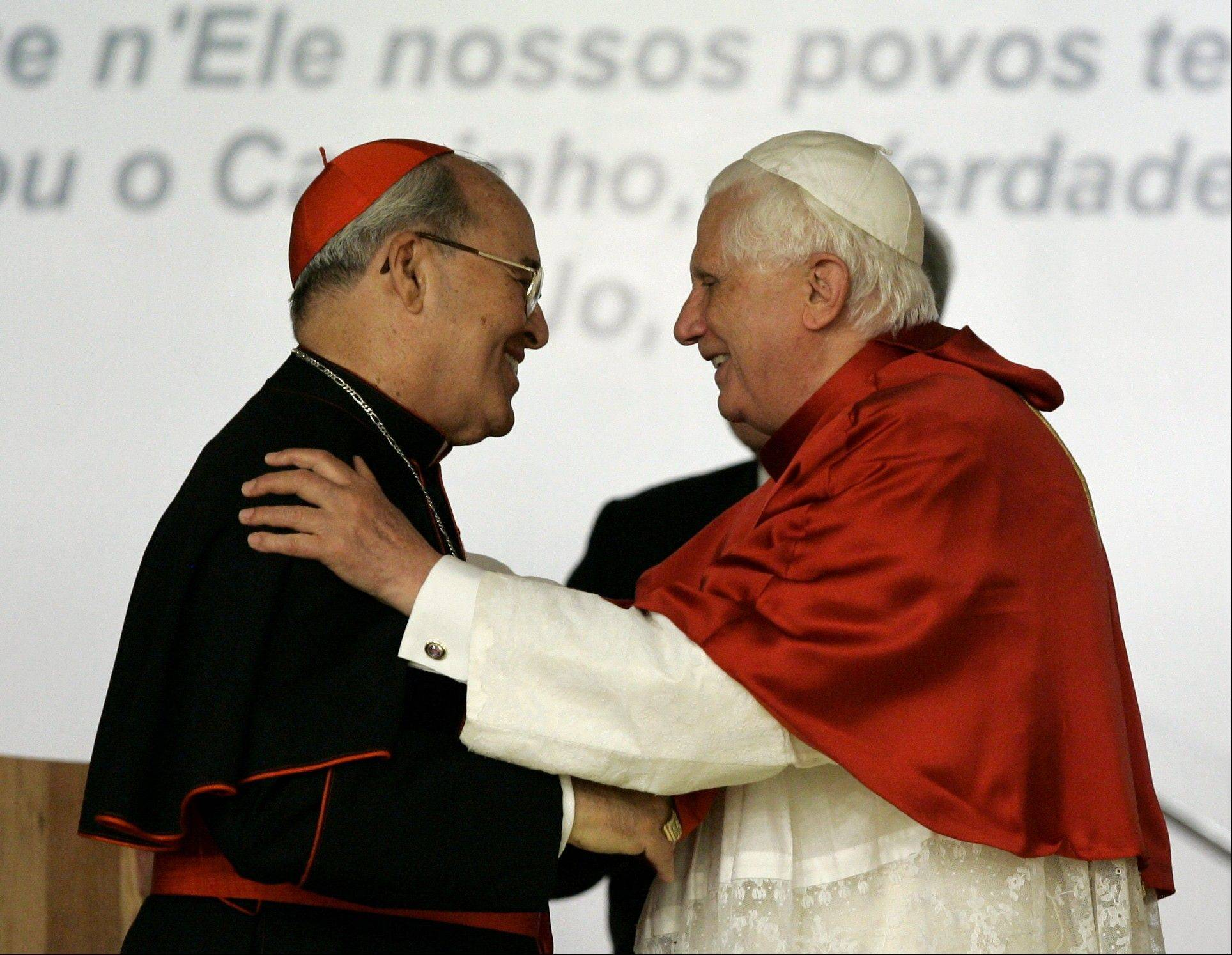 Pope Benedict XVI, right, embraces Cardinal Jaime Ortega Alamino, Archbishop of Havana, Cuba, during the inauguration ceremony of the V Conference of Latin American and the Caribbean Bishops in Aparecida, Brazil. When a young parish priest named Jaime Ortega was freed from detention at the height of the communist onslaught against religion in Cuba, his father handed him a one-way ticket to Spain and urged him not to look back. But Ortega refused to go. Today, he is Cuba's cardinal, about to receive a visit from Pope Benedict XVI while playing an important role in coaxing President Raul Castro's government along the path of reform.
