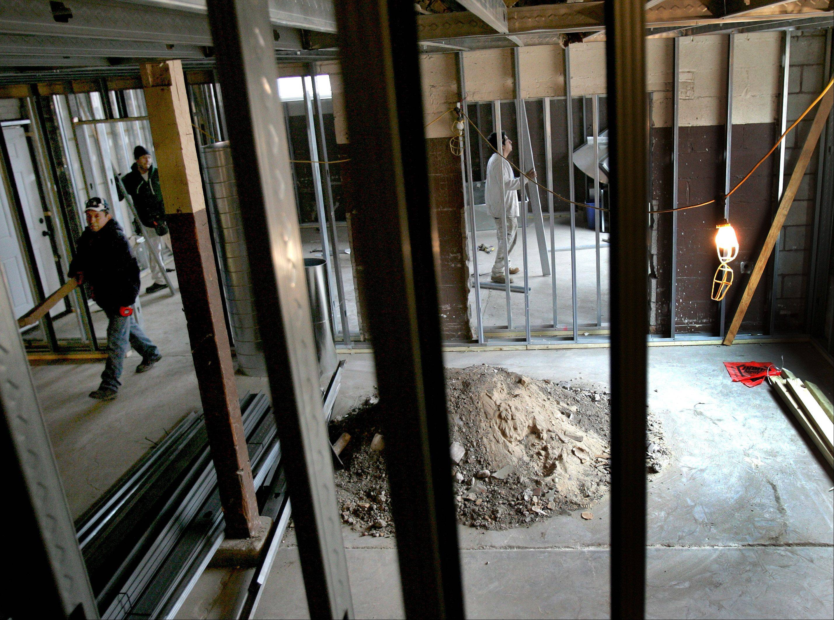 Workers are preparing the building at the northwest corner of Park Avenue and St. Charles Road in downtown Lombard to become The Corner House coffee shop by March or April.