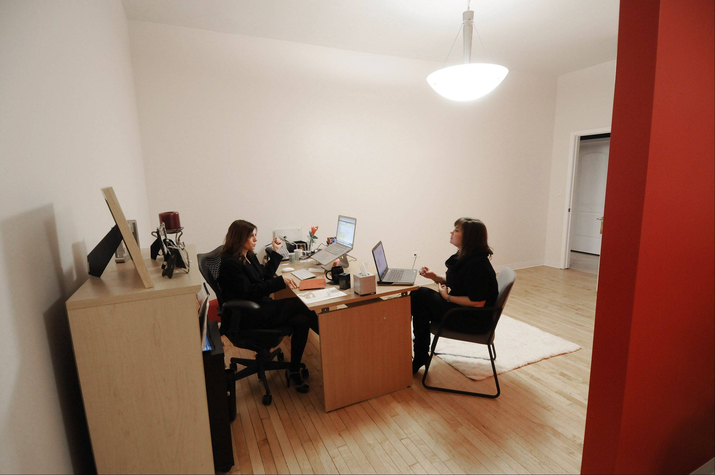 Kathy Steele and Julie Poulos meet in the new downtown Lombard offices of Desert Rose Design. The marketing and graphic design firm moved into 106 W. St. Charles Road in January, filling a space that had been vacant about three years.