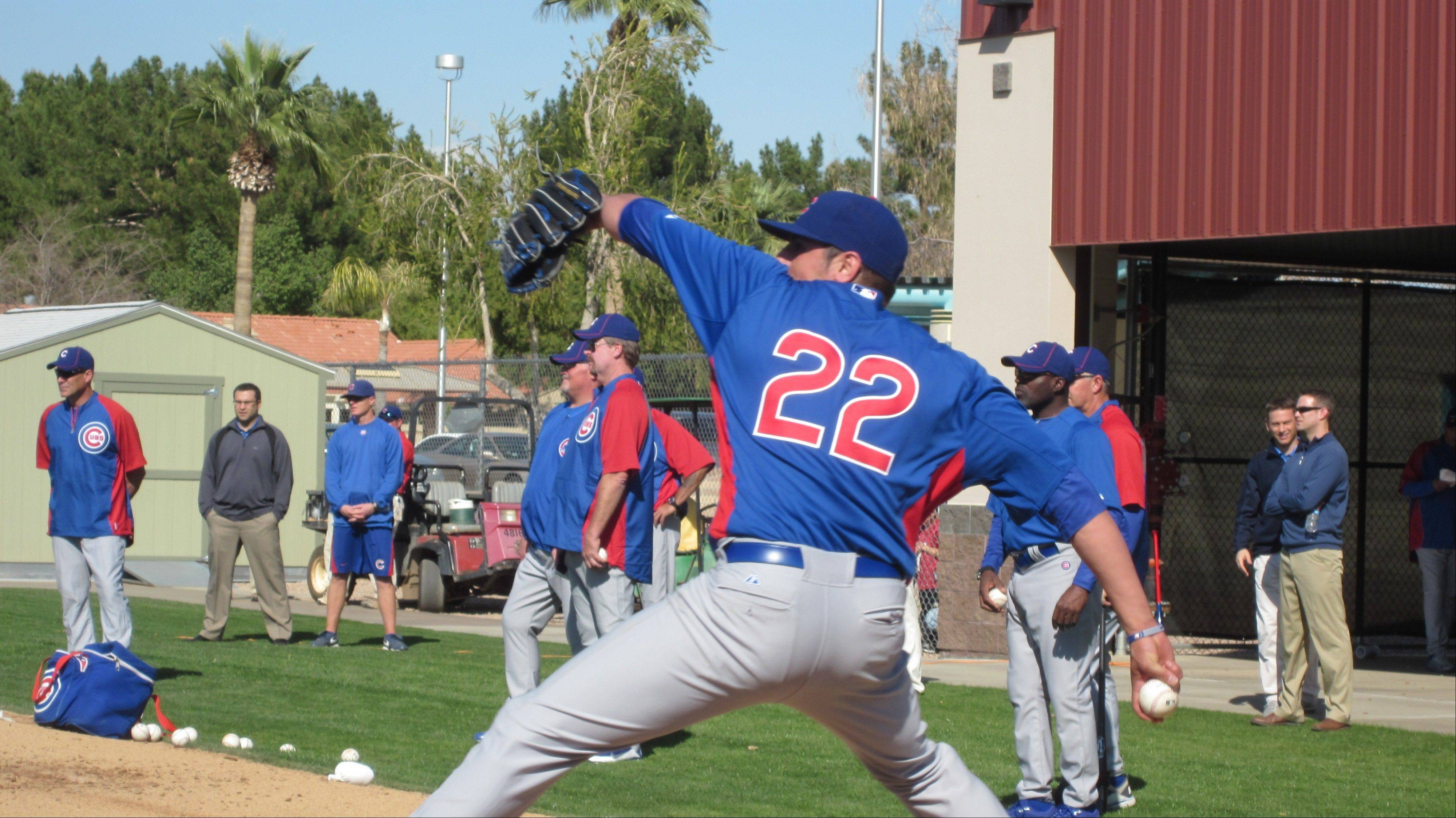 Cubs starter Matt Garza gets in some throwing Sunday, the first day of workouts for pitchers and catchers in Mesa, Ariz.
