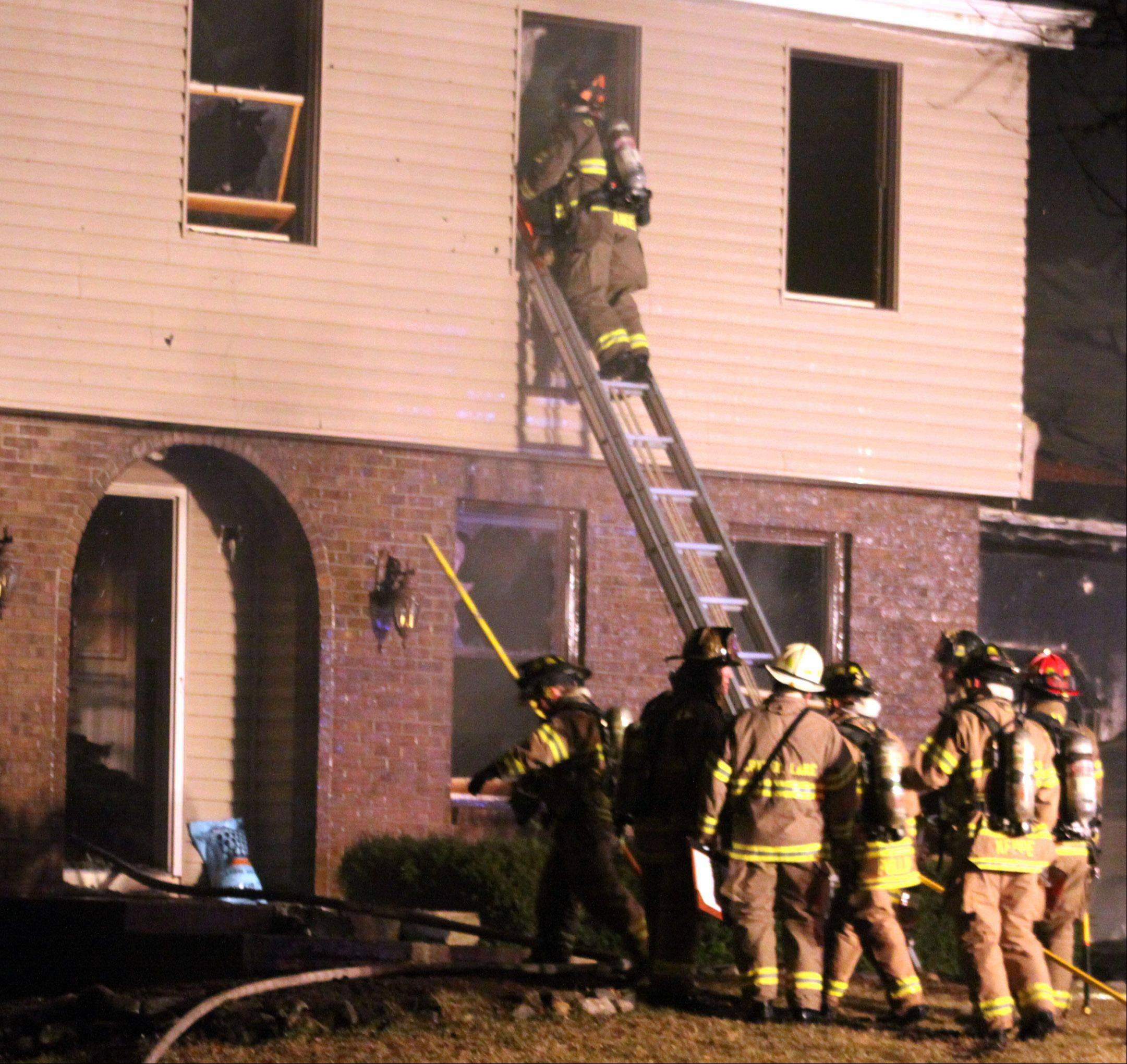 Firefighters had to knock out numerous windows while battling a house fire Monday in Algonquin.