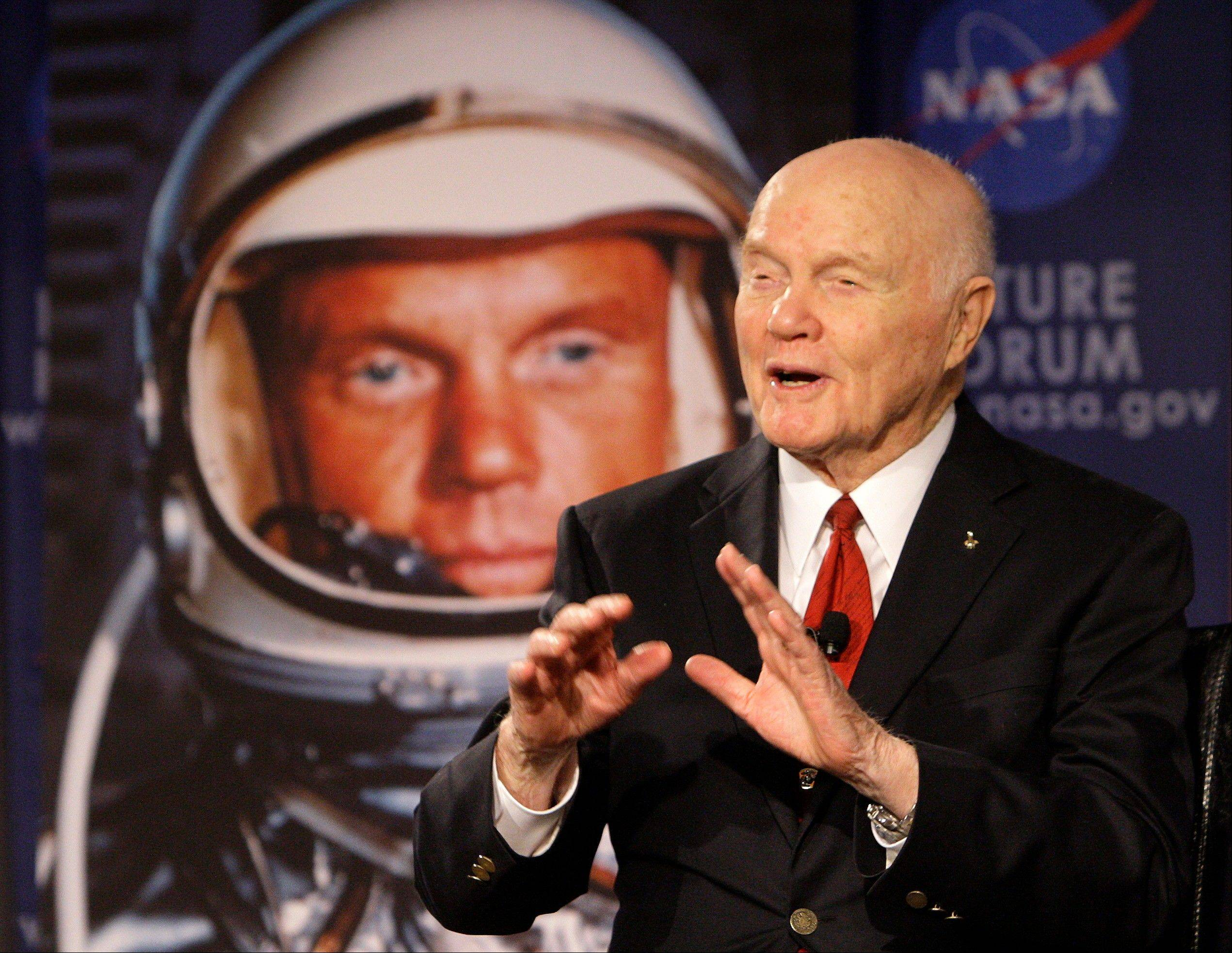 "Sen. John Glenn talks, via satellite, with the astronauts on the International Space Station, before the start of a roundtable discussion titled ""Learning from the Past to Innovate for the Future"" Monday, Feb. 20, 2012, in Columbus, Ohio. Glenn was the first American to orbit Earth, piloting Friendship 7 around it three times in 1962, and also became the oldest person in space, at age 77, by orbiting Earth with six astronauts aboard shuttle Discovery in 1998."