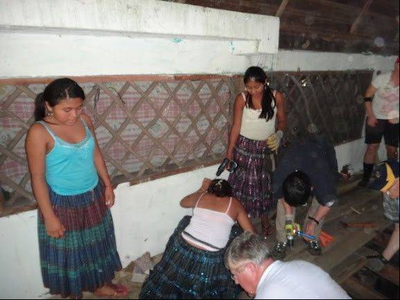 Rotarian Walter Wolnik, kneeling center, works alongside Mayan students at Ak'Tenamit School in Guatemala as part of a Rotary International trip this month.