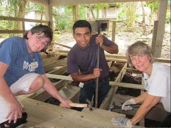 Amy Charlesworth, right, and Diane Crawford assist Joaquin, a graduate of Ak'Tenamit School in Guatemala, build a deck as part of a Rotary International trip this month.