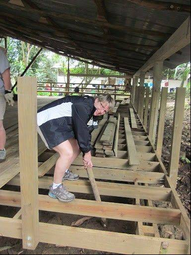 Rita Fletcher, director of the Bartlett Park District, working on a deck at Ak'Tenamit School in Guatemala as part of a Rotary International trip this month.