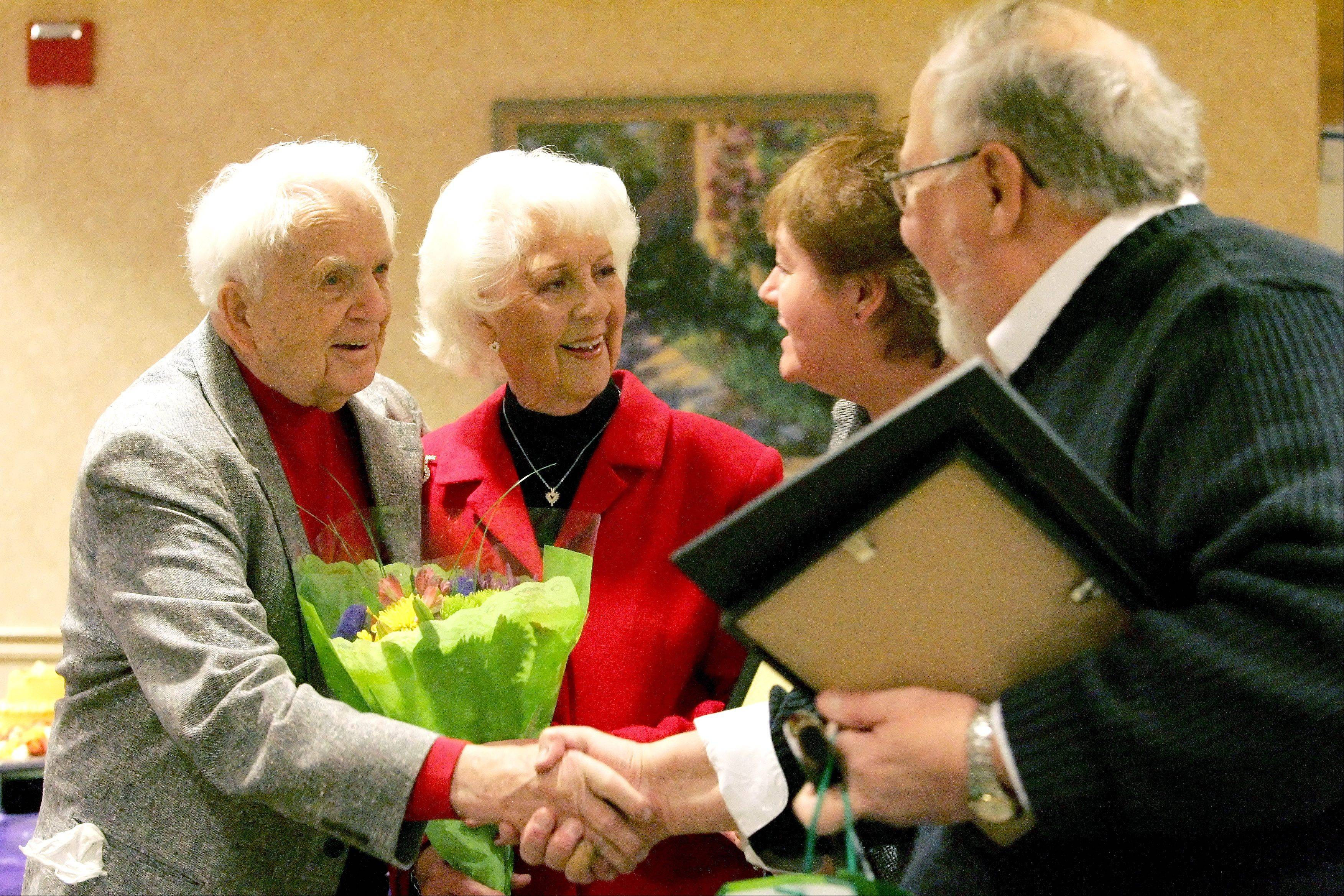 Dale and Doris Chatfield of Aurora, left, are honored for being Illinois' longest-married couple by Kathy and Lloyd Christensen, executive couple with Chicago-Gary Diocese for World Wide Marriage Encounter on Friday at Alden Gardens of Waterford assisted living. This year the couple will be married 74 years.