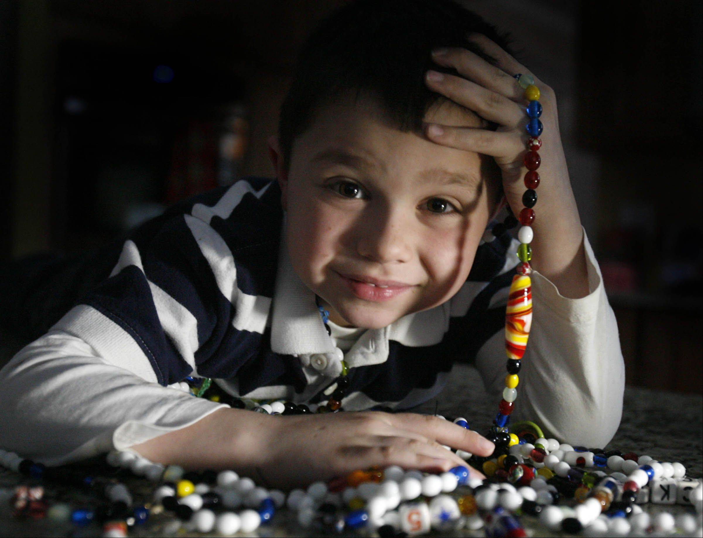 Mundelein first-grader Jack Czapla, 6, of Mundelein is fighting leukemia and was named the Leukemia and Lymphoma Association Boy of the Year for 2012. Here with beads nurses gave him while he was in the hospital.