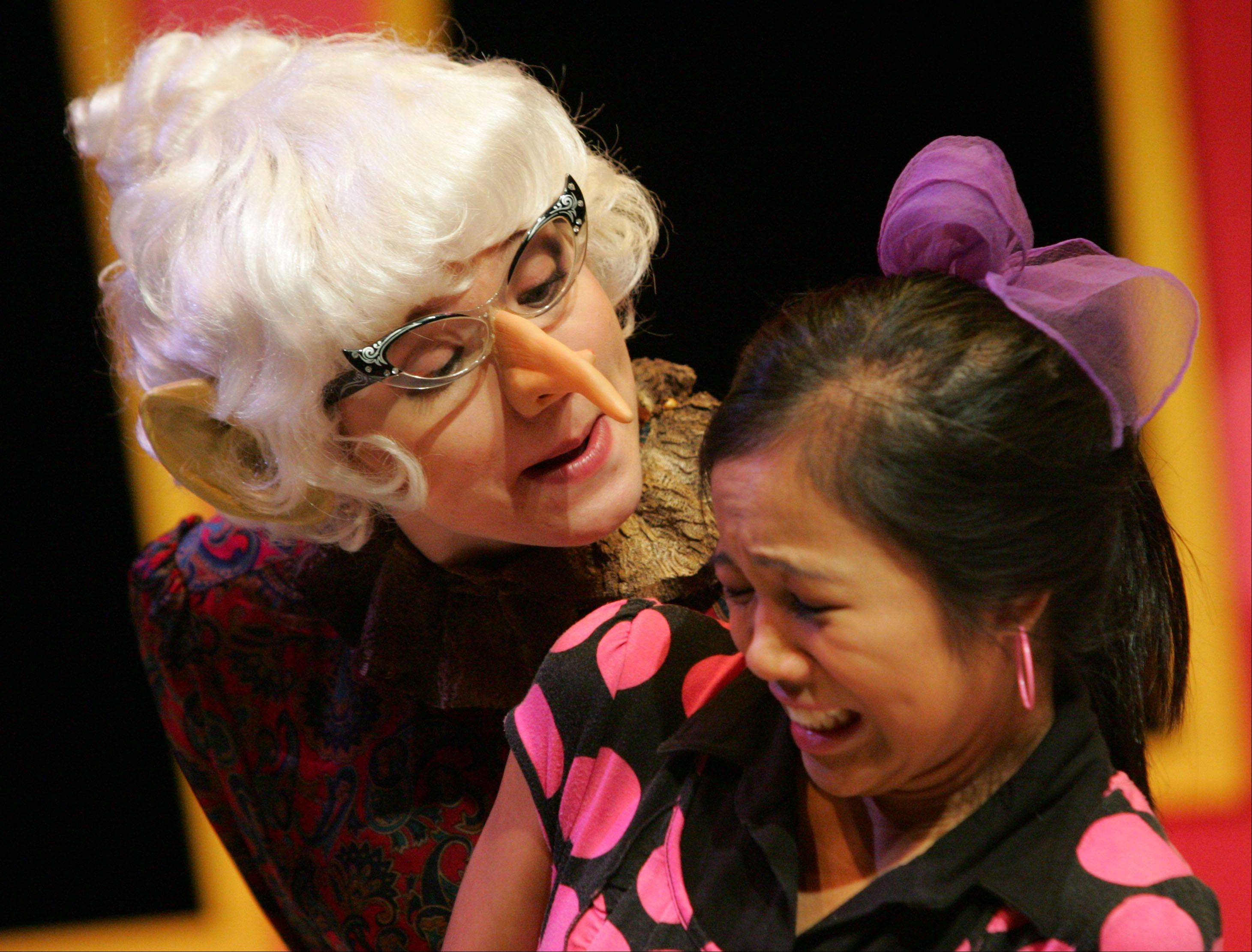 "Vernon Hills High School senior Maggie Gorski, left, plays the roll of Mrs. Gorf and sophomore Chelsea de Lara plays the roll of Bebe during a winter matinee of their play ""Sideways Stories from Wayside School"" for 3-5 graders from Hawthorn Elementary North Friday in Vernon Hills."