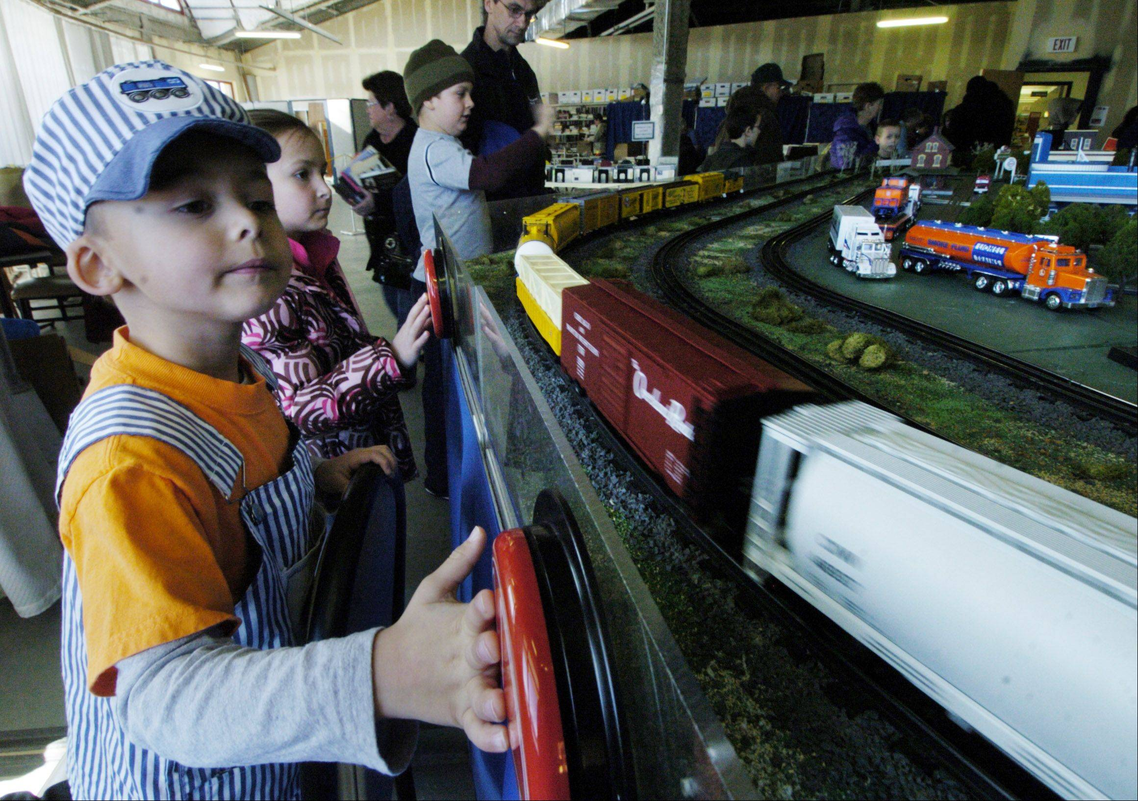 Ryan Phoenix, 5, of Mundelein watches a train pass as the North Central O Guagers railroad club holds a showing of its layout at the Fremont Public Library in Mundelein Saturday.