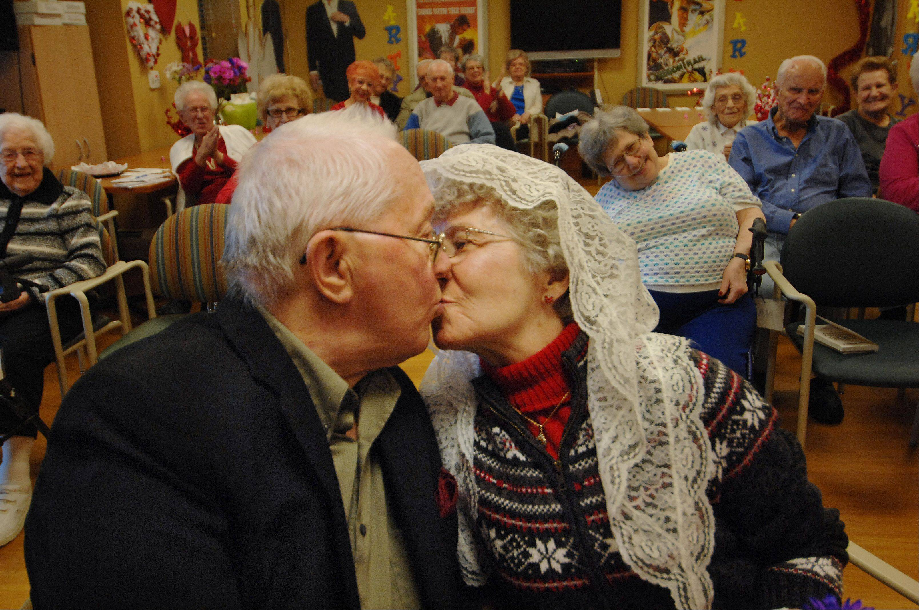 Art and Helen Polich kiss to seal their vows Tuesday at the Victory Centre of Barlett. The couple first married on April 15, 1950, and now live at the supportive living facility. They renewed their vows after 62 years, on Valentine's Day.