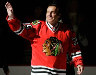 Former Chicago Blackhawks goalie Tony Esposito waves to the crowd as he is honored before a  game  in 2008.