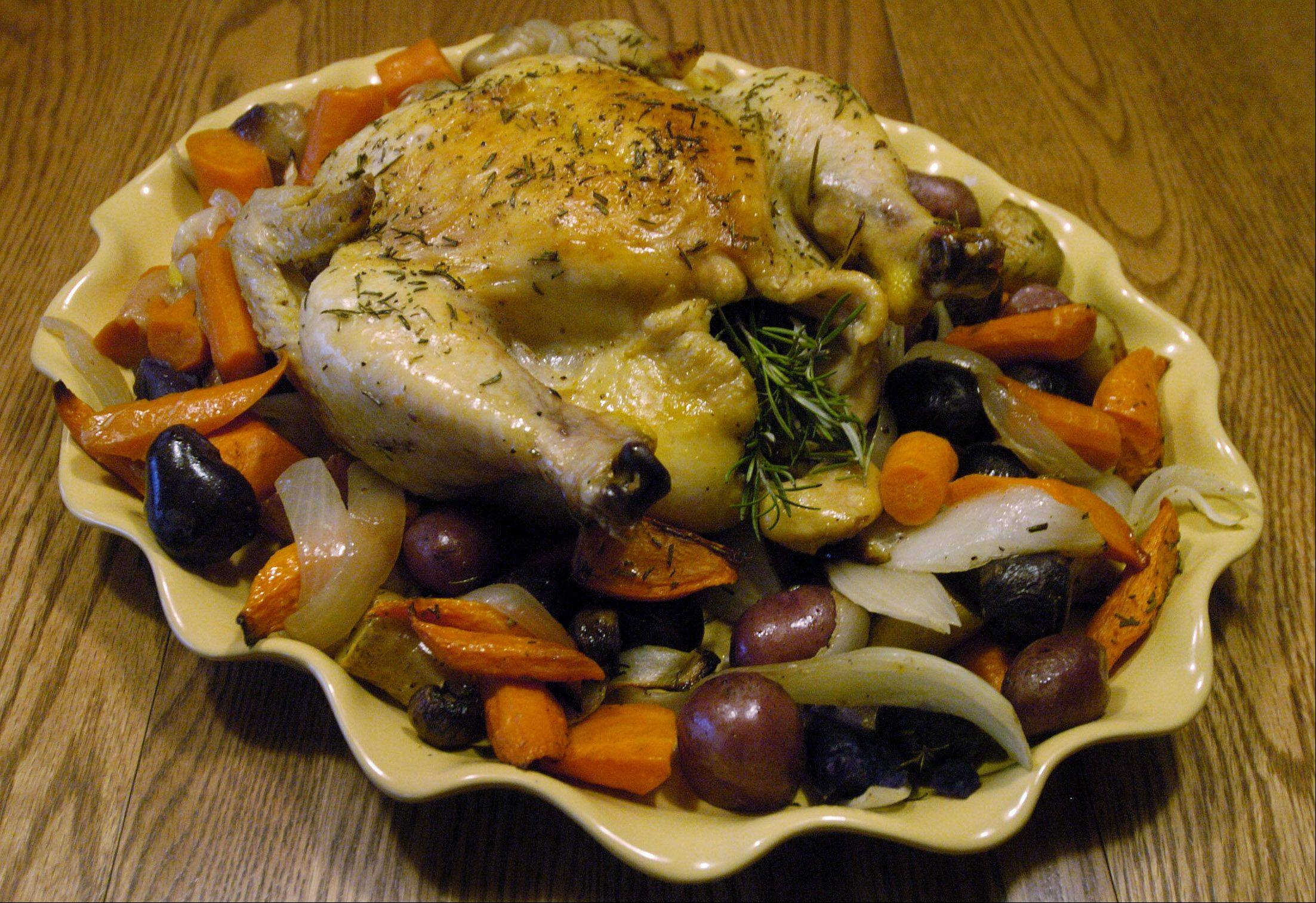 A Dutch oven is the perfect vessel for cooking roasted chicken and vagetables.