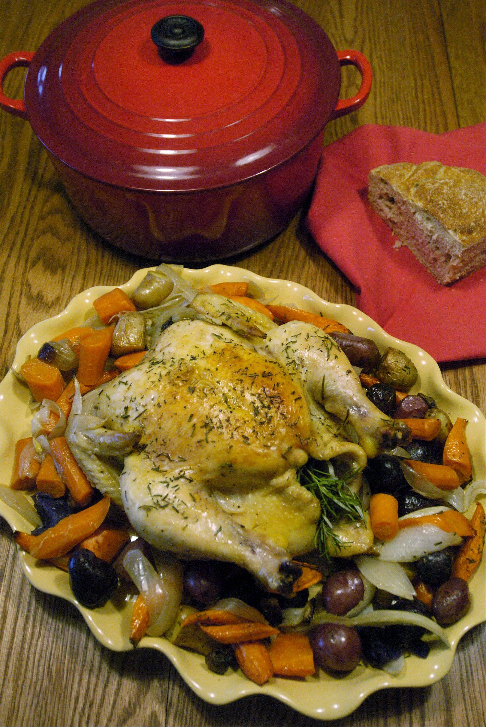 A Dutch oven can go from the stove-top to the oven, making this roasted chicken and vegetables a one-pot meal