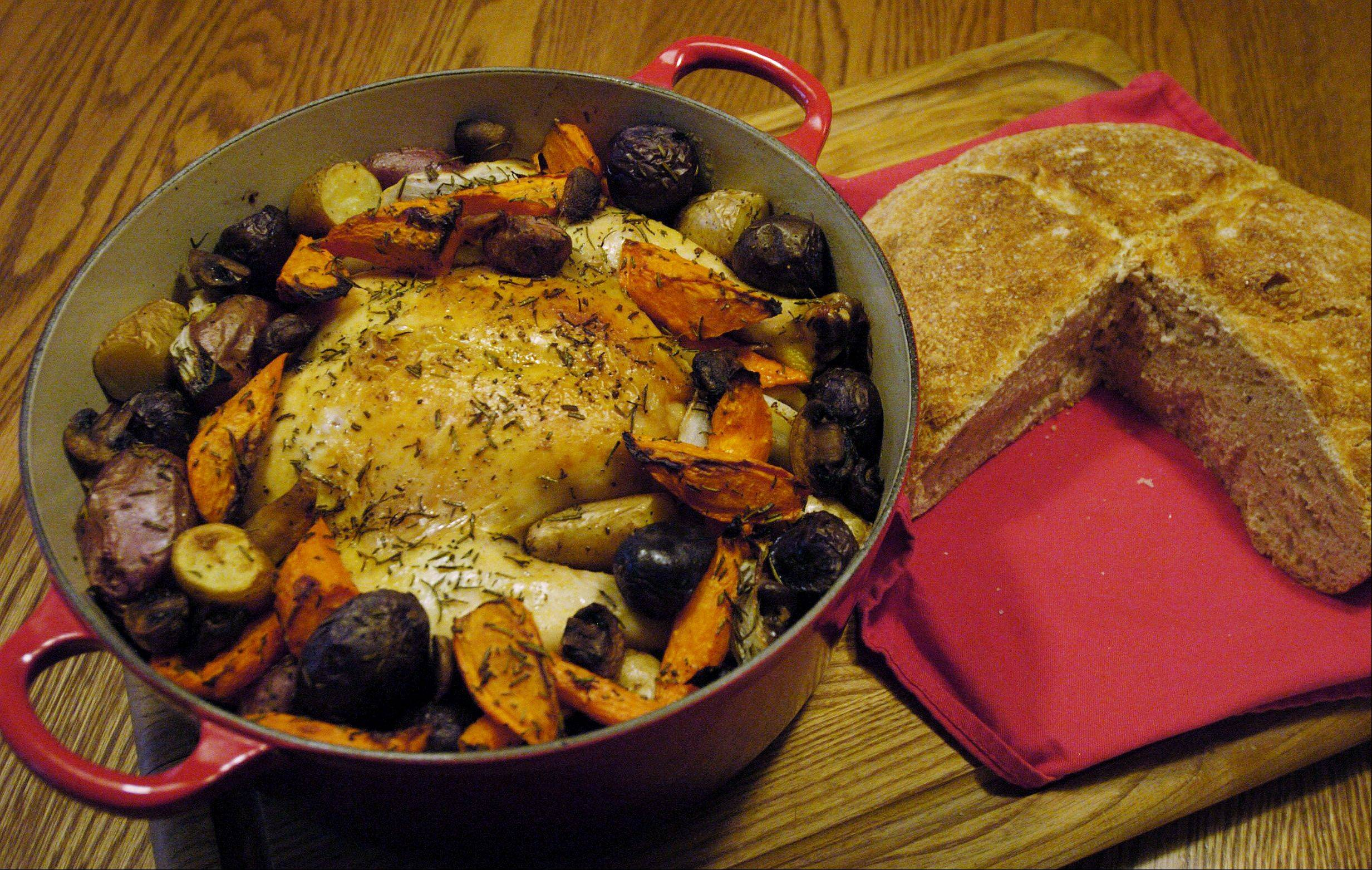 A cast-iron Dutch oven roasts chicken as evenly as it bakes bread.