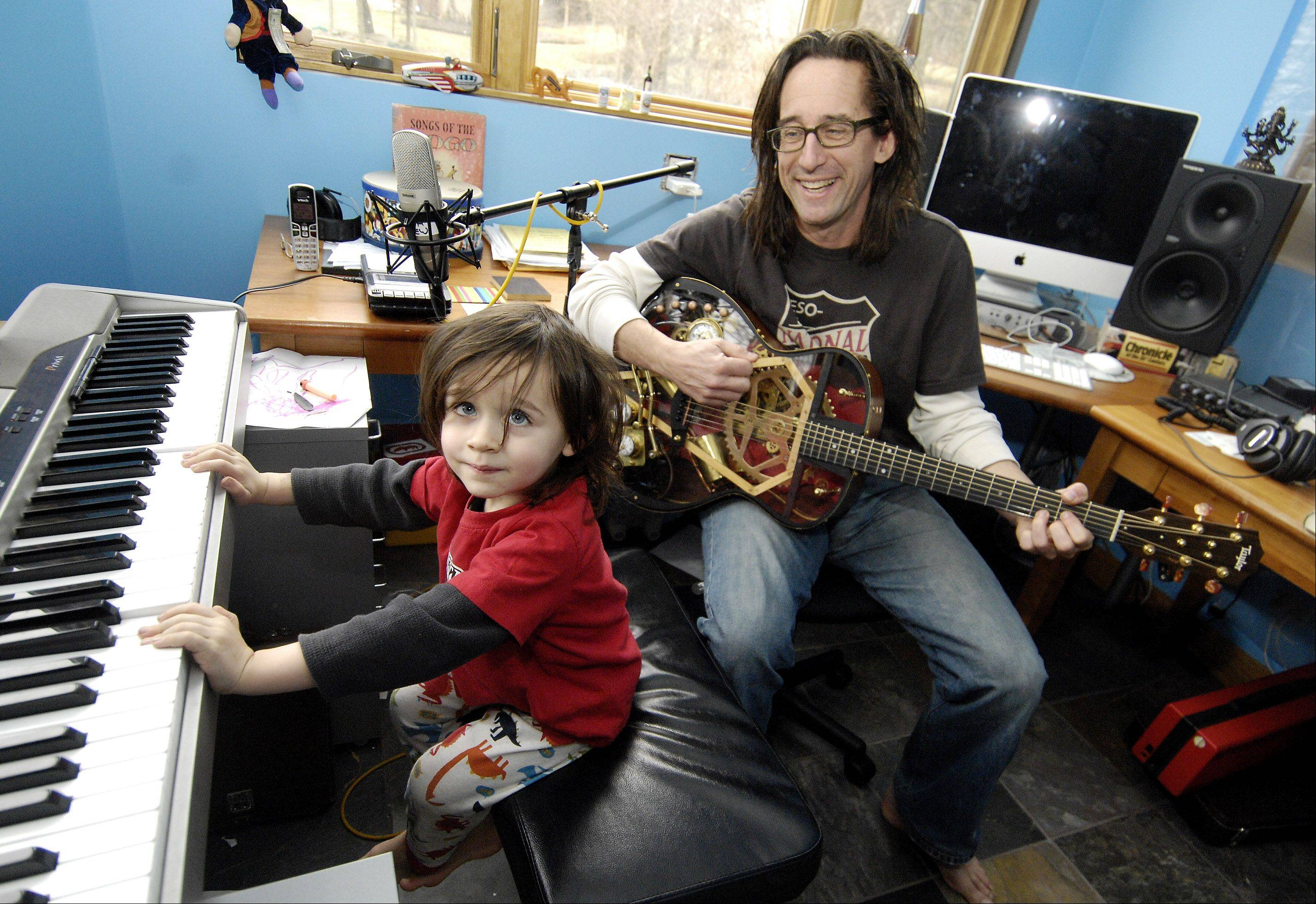 Ralph Covert of Glen Ellyn, frontman for The Bad Examples and Ralph's World, plays music with his son Jude, 2.